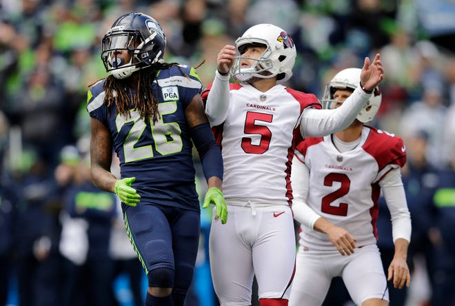 Seattle Seahawks' Shaquill Griffin (26) watches the path of Arizona Cardinals' Zane Gonzalez's (5) field goal as Cardinals holder Andy Lee (2) looks on during the first half of an NFL football game, Sunday, Dec. 30, 2018, in Seattle.