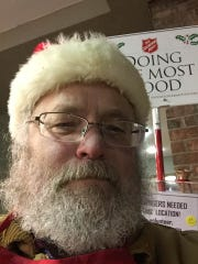 Bob Gross ringing the bell for the Salvation Army Red Kettle Campaign Dec. 5 at Neiman's Market in St. Clair.