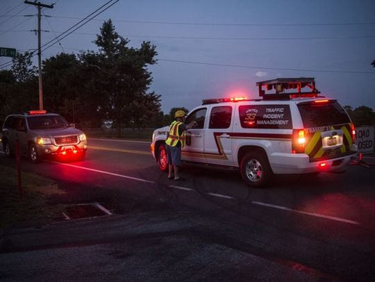 In this photo from Aug. 18, 2016, a member of the fire police talks to an emergency official near the site of a double-fatal crash on Baltimore Pike and Bermudian Church Road in Washington Township.
