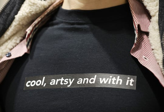"""Bleu Cease, of the Rochester Contemporary Art Center, with the """"cool, artsy and with it"""" T-shirt inspired by a vicious piece of hate mail."""