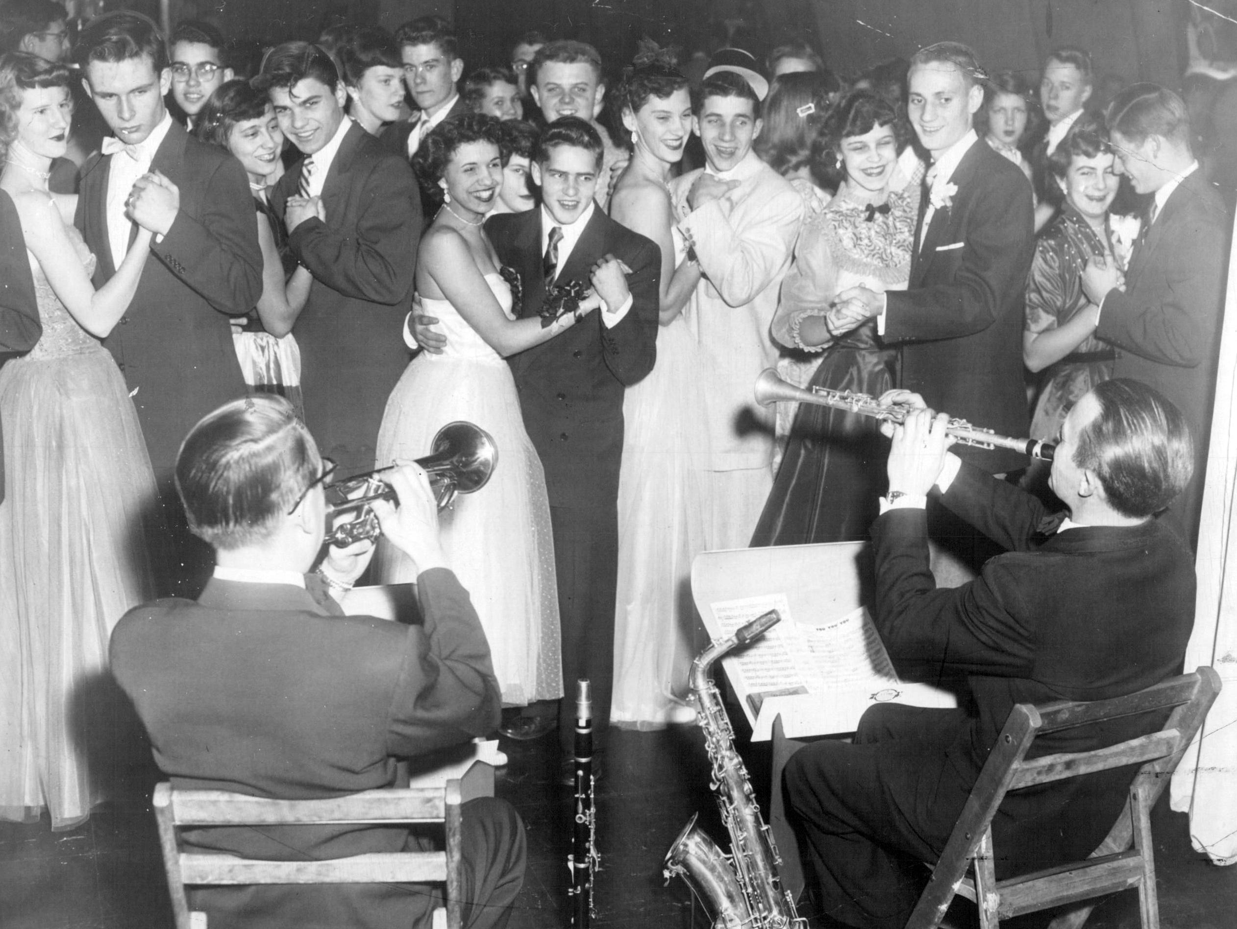 his group says farewell to 1953 and hello to 1954 during a New Year's Eve dance at The Barn, a Gannett