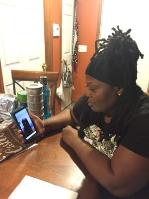Lashanda Castel video chats with her  husband Reginald Castel, who was deported to Haiti in 2017.