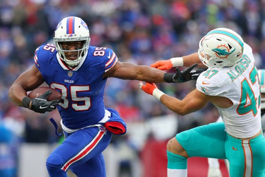 Buffalo Bills tight end Charles Clay (85) runs with the ball after a catch as Miami Dolphins outside linebacker Kiko Alonso (47) pursues during the second quarter of Sunday's game at New Era Field.