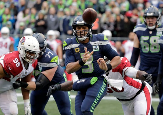 Seattle Seahawks quarterback Russell Wilson (3) passes against the Arizona Cardinals during the first half of an NFL football game, Sunday, Dec. 30, 2018, in Seattle.