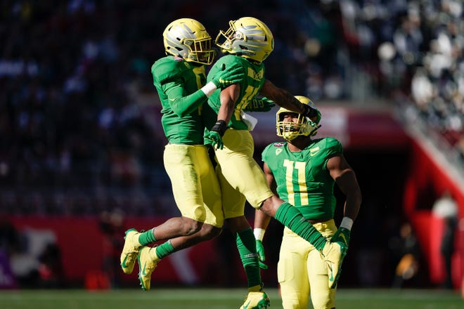 Dec 31, 2018; Santa Clara, CA, USA; Oregon Ducks safety Jevon Holland (8) and safety Nick Pickett (16) celebrate against the Michigan State Spartans during the second quarter at Levi's Stadium. Mandatory Credit: Stan Szeto-USA TODAY Sports