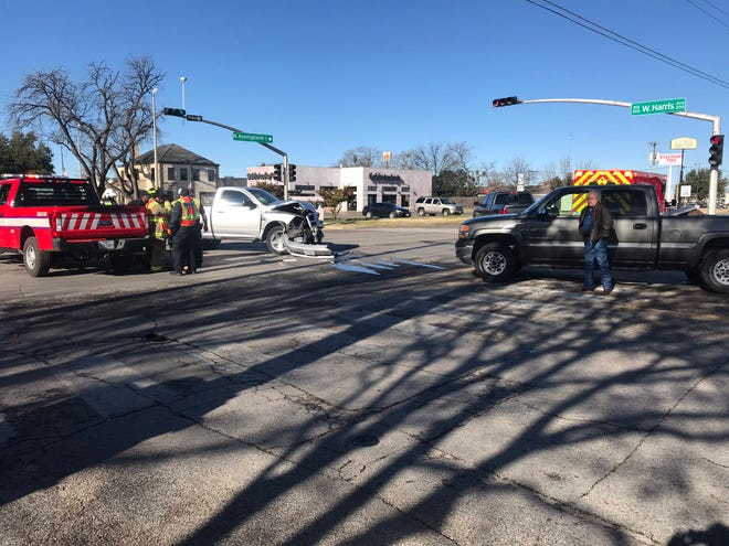 Two pickups collide at the intersection of North Koenigheim Street and West Harris Avenue Monday, Dec. 31, 2018.