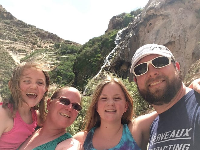 Lisa Collier, second from left, poses with her family, from left, Emily Spurgin, Grace Spurgin and James Hurley. Hurley died in a wreck Dec. 26, 2018. Emily and Grace Spurgin and Lisa Collier were injured.