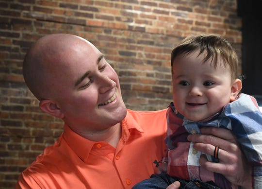 Tyler Watkinson poses with his son Grayson.