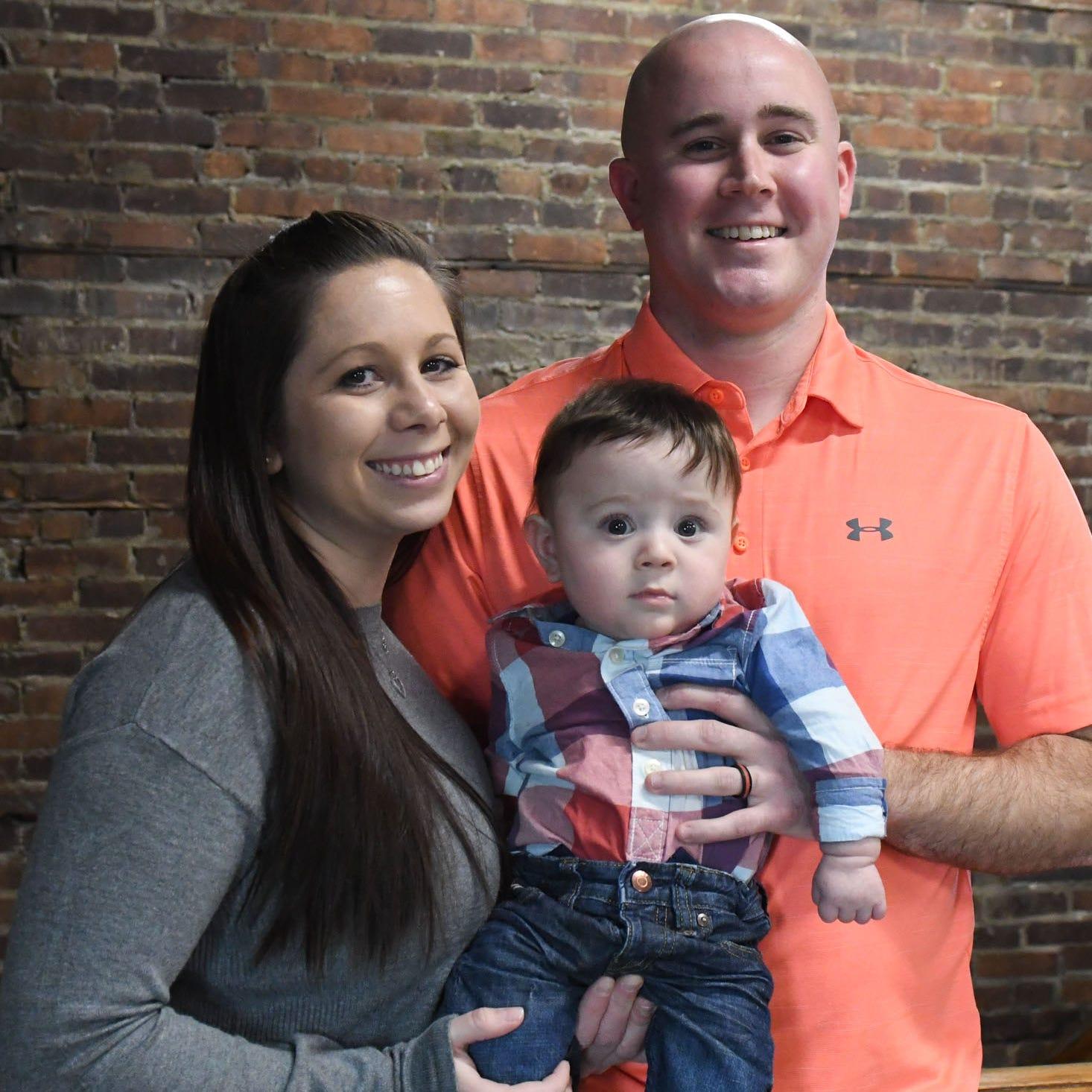 Nikki and Tyler Watkinson with their son Grayson.