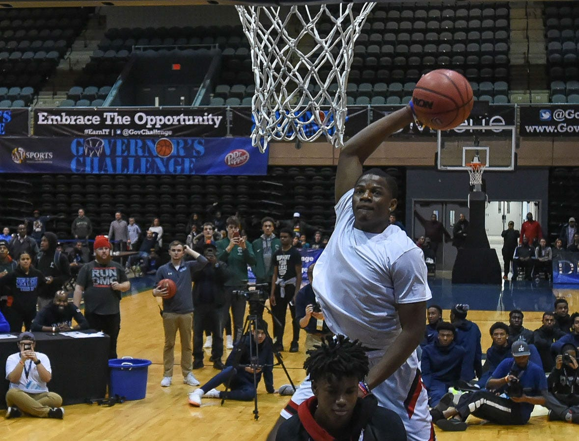 Veritas Prep's Iverson Molinar dunks the ball in the slam dunk competition at the Governor's Challenge in Salisbury on Friday, Dec. 28, 2018.