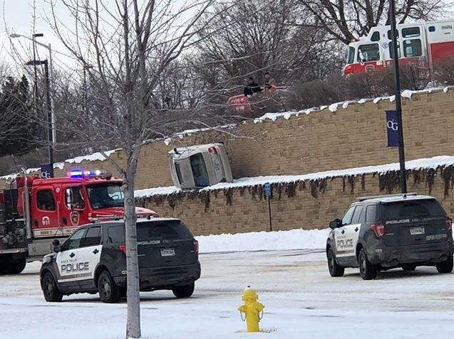 A car went over a retaining wall at O'Gorman High School on Sunday, Dec. 30, 2018 after the driver had a medical emergency, police say.