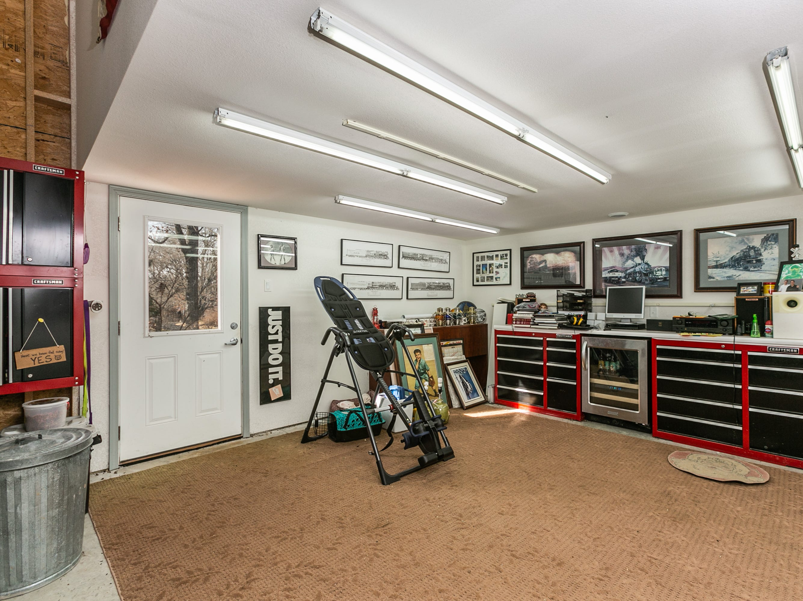 This hobby area/workout space occupies a corner of the larger second garage. It too could easily be converted for a number of alternate uses.