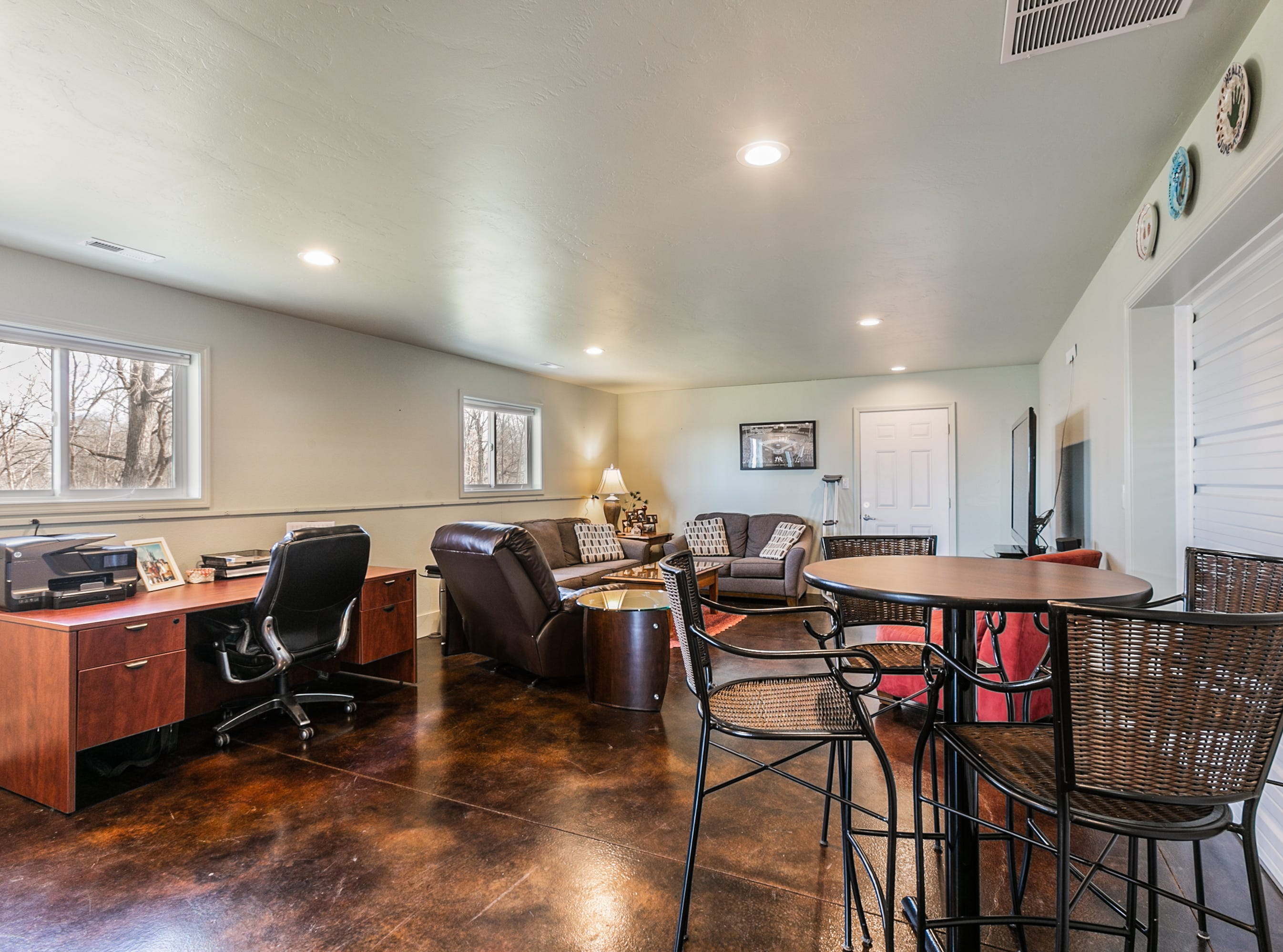 The Grahams created a man cave out of a second garage. With a large garage door and finished concrete floors, it easily could be reverted back to garage space.