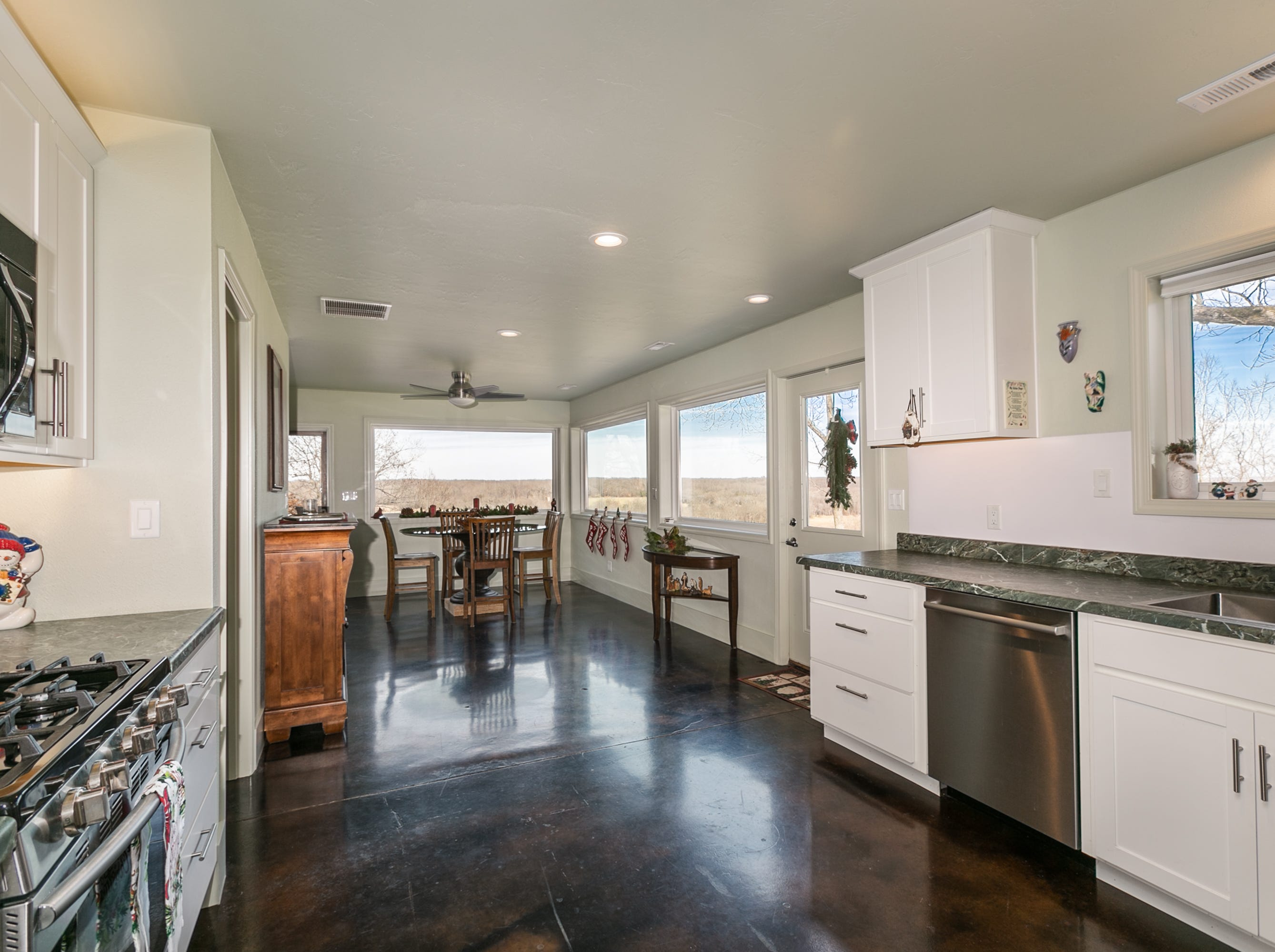 The full-size kitchen offers plenty of space to cook and a gas-burning range. It's just steps from the dining area as well as the man cave, which makes entertaining easy.