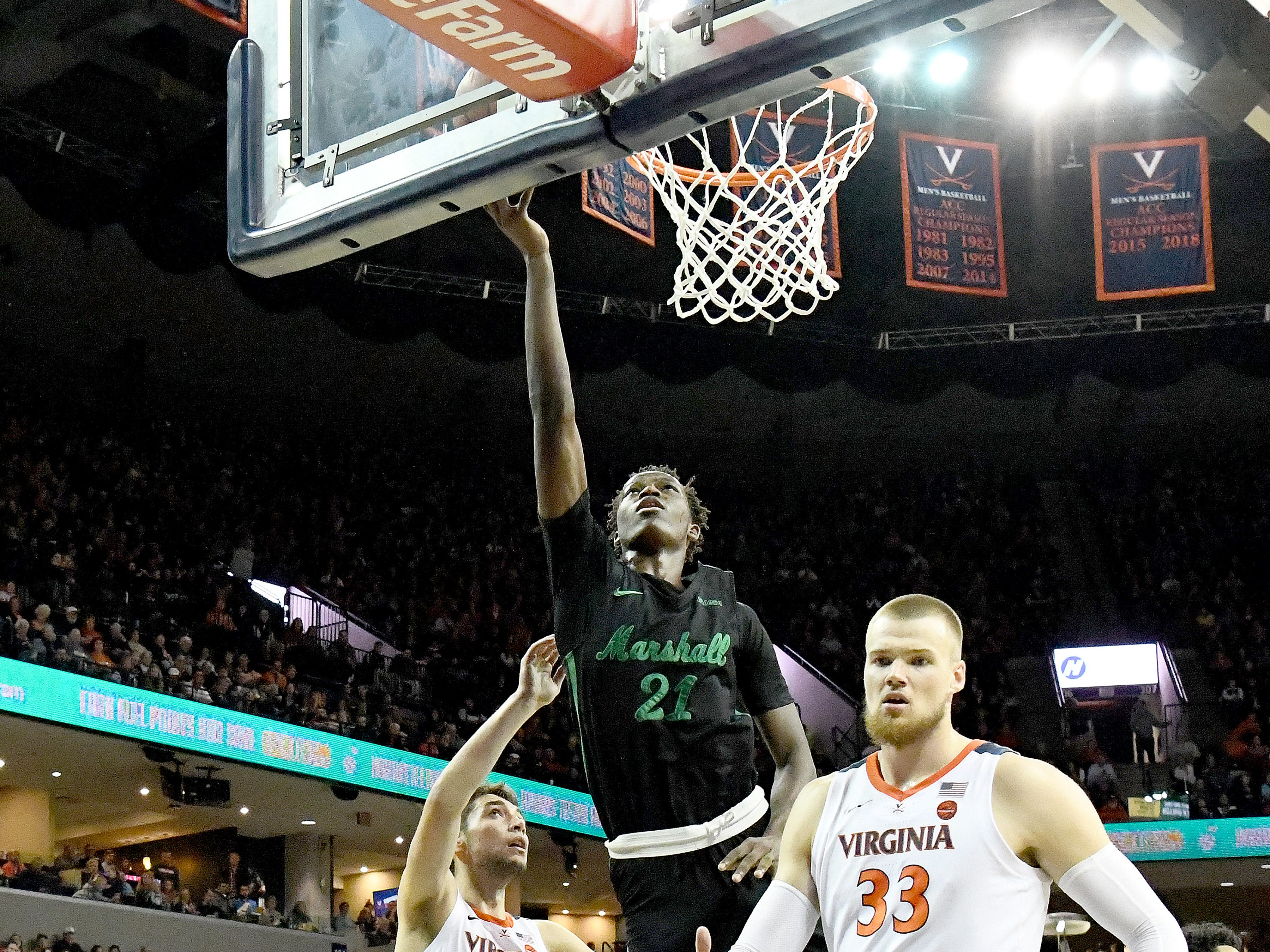 Marshall's Darius George, former R.E. Lee star, shoots during their game against University of Virginia, played at the John Paul Jones Arena on Dec. 31, 2016.