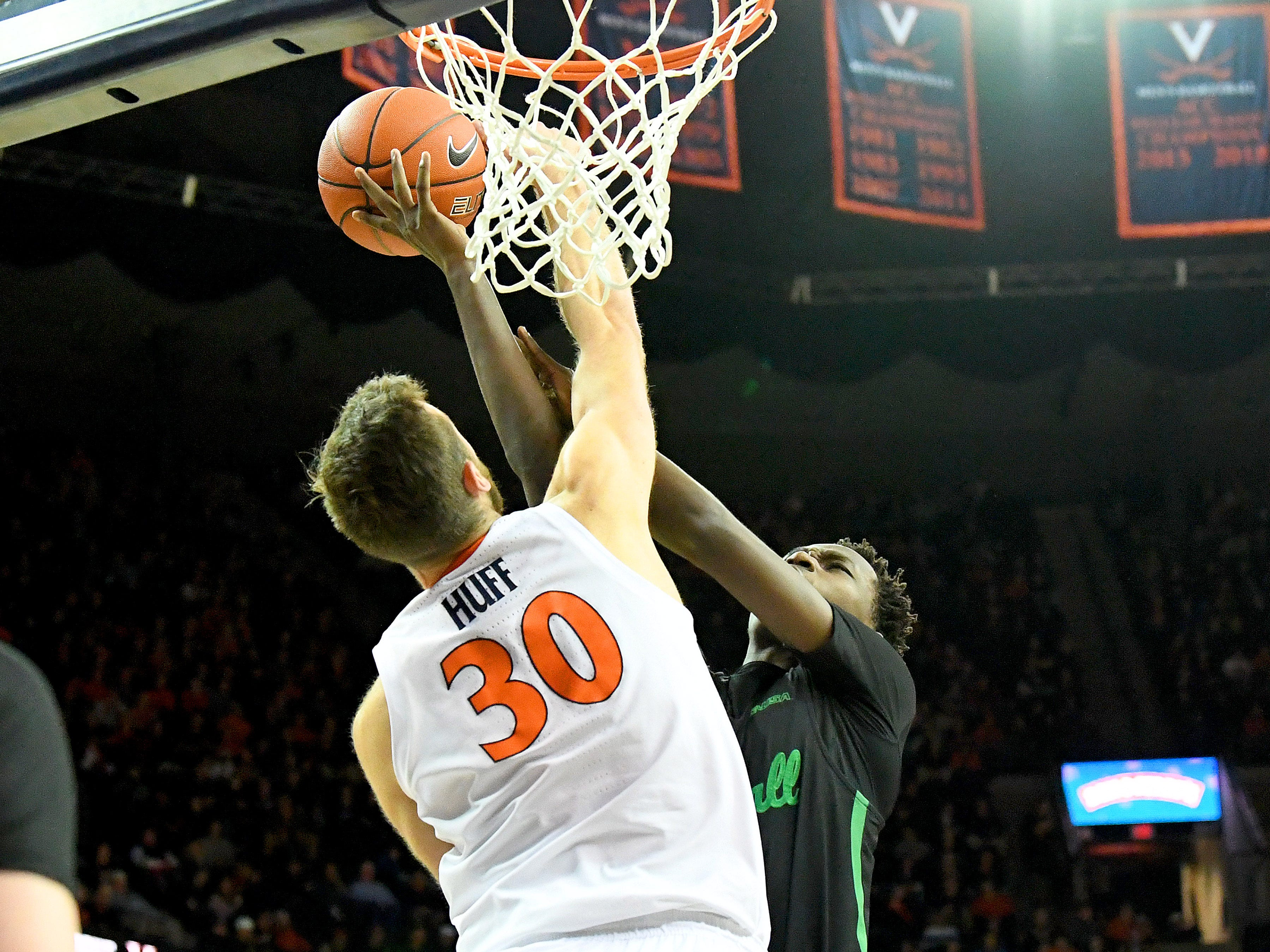 Marshall's Darius George, former R.E. Lee star, tries to get the ball in the basket while guarded by Virginia's Jay Huff during their game against University of Virginia, played at the John Paul Jones Arena on Dec. 31, 2016.