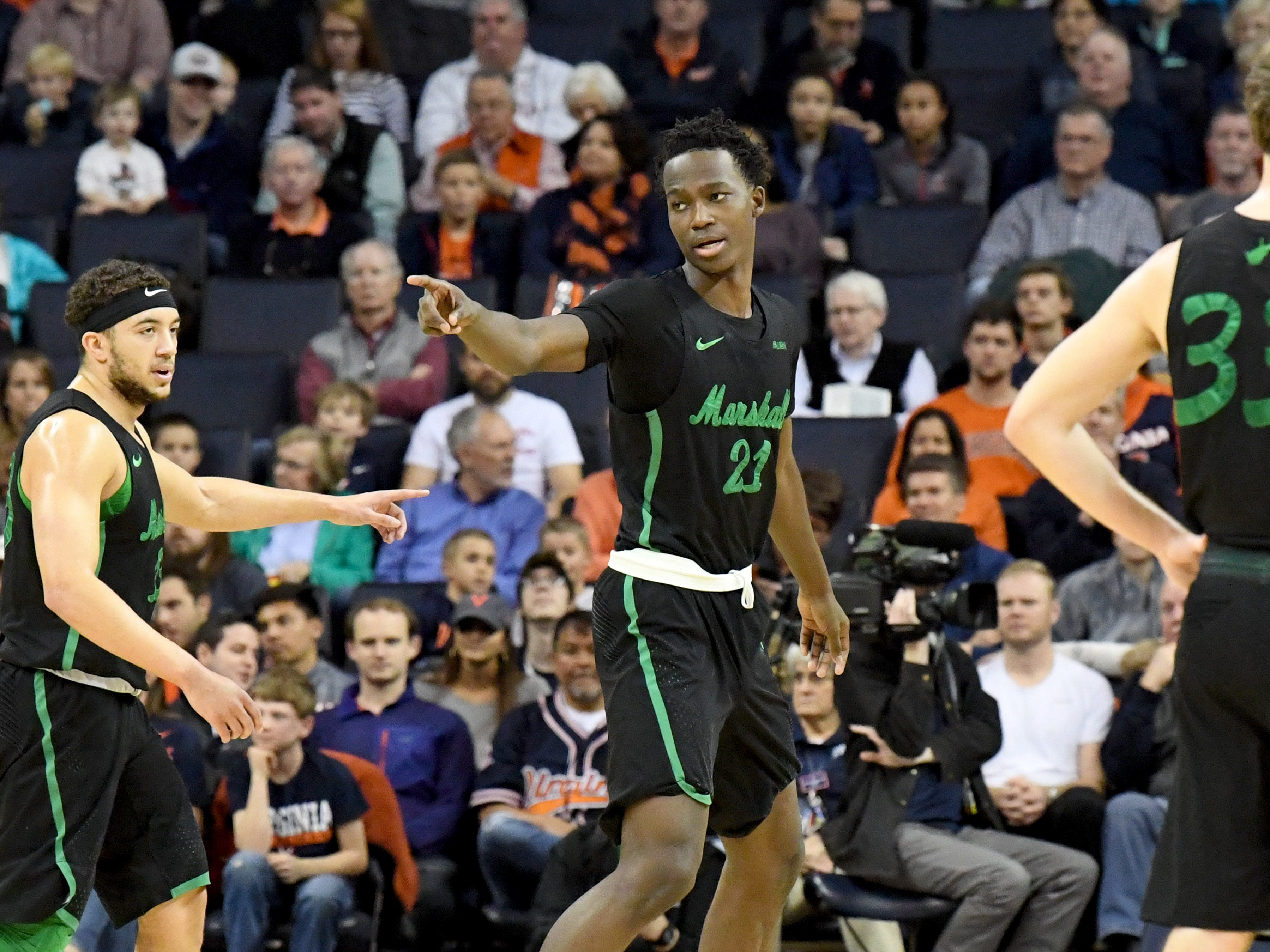 Marshall's Darius George, former R.E. Lee star, points as he communicates with teammates during their game against University of Virginia, played at the John Paul Jones Arena on Dec. 31, 2016.