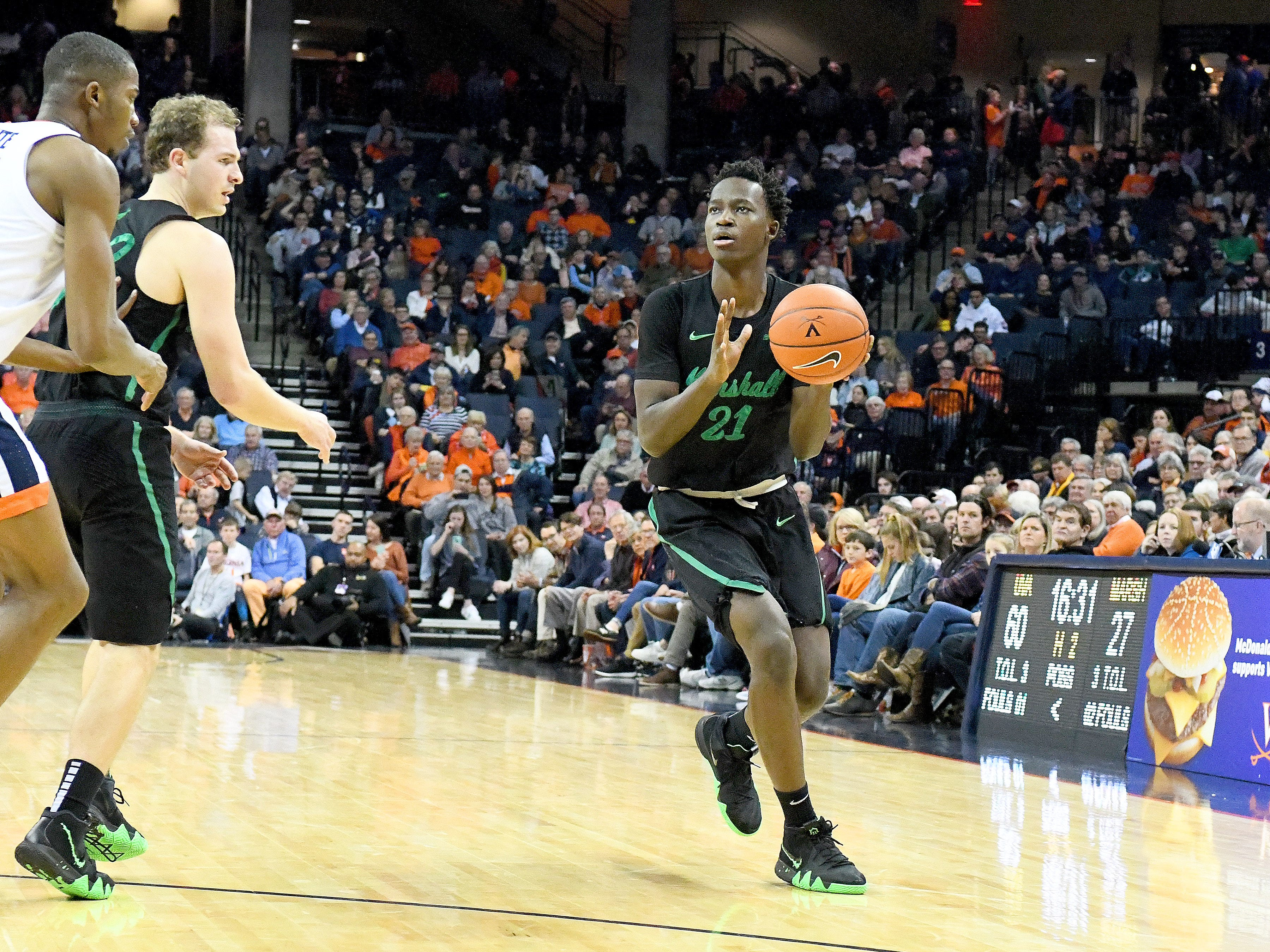 Marshall's Darius George, former R.E. Lee star, looks to shoot during their game against University of Virginia, played at the John Paul Jones Arena on Dec. 31, 2016.