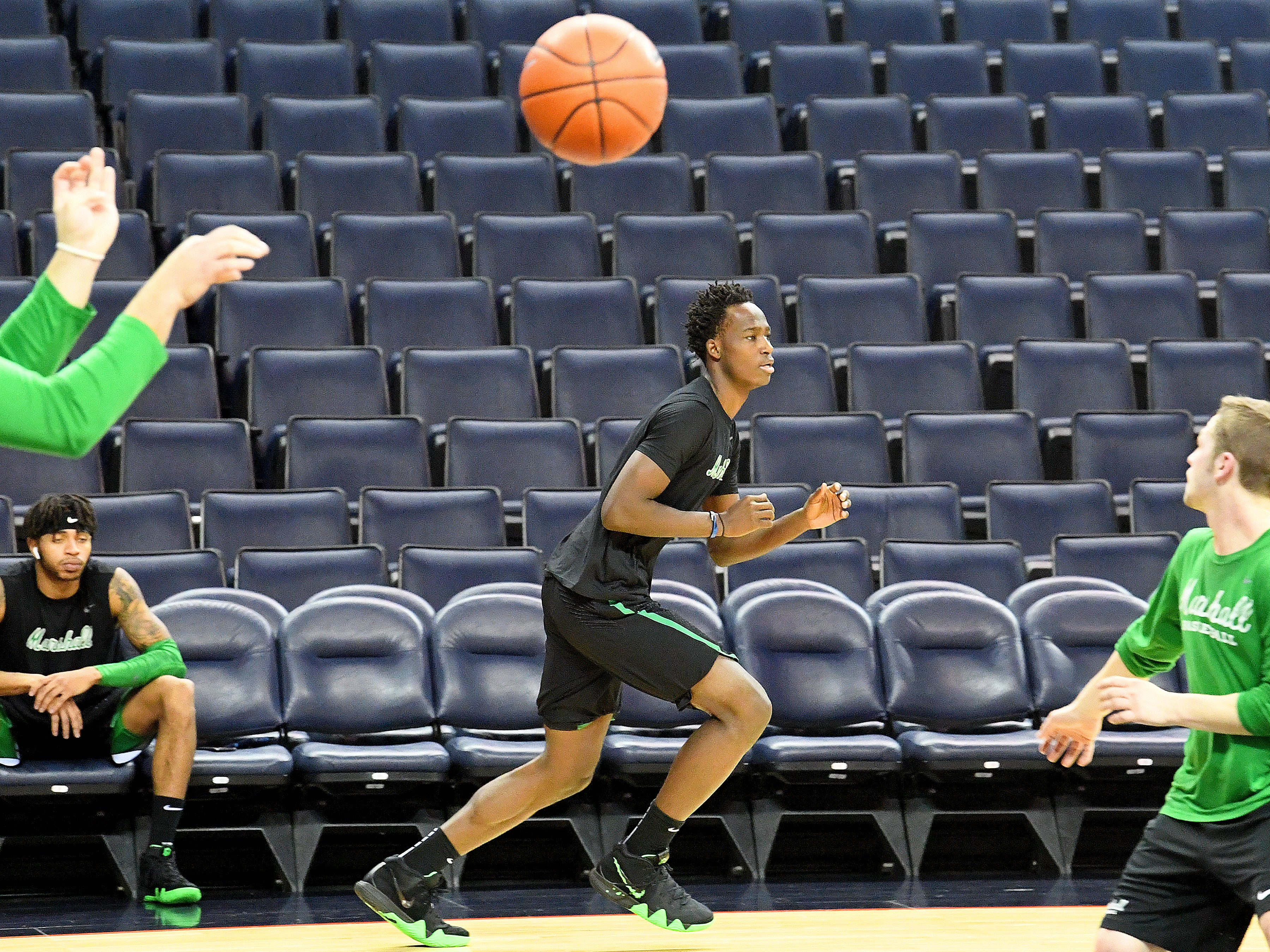 Marshall's Darius George, former R.E. Lee star, warms up with team before the start of their game against University of Virginia, played at the John Paul Jones Arena on Dec. 31, 2016.