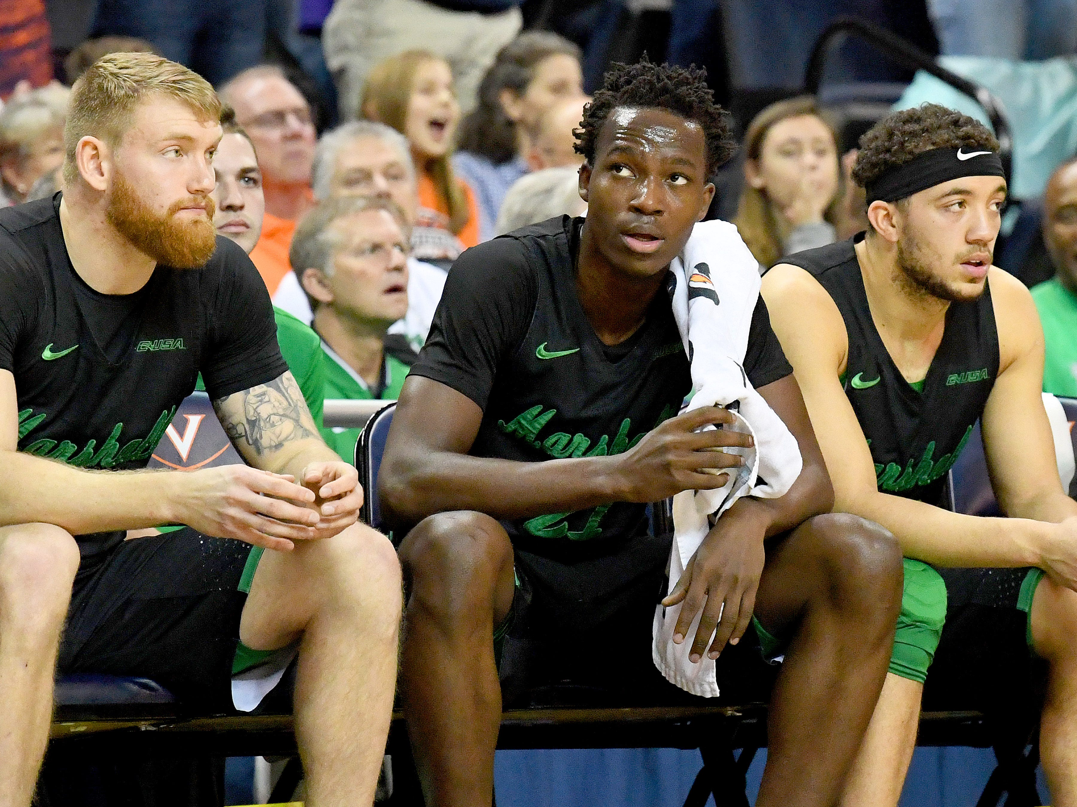 Marshall's Darius George, former R.E. Lee star, watches the action on the court from the sidelines during their game against University of Virginia, played at the John Paul Jones Arena on Dec. 31, 2016.