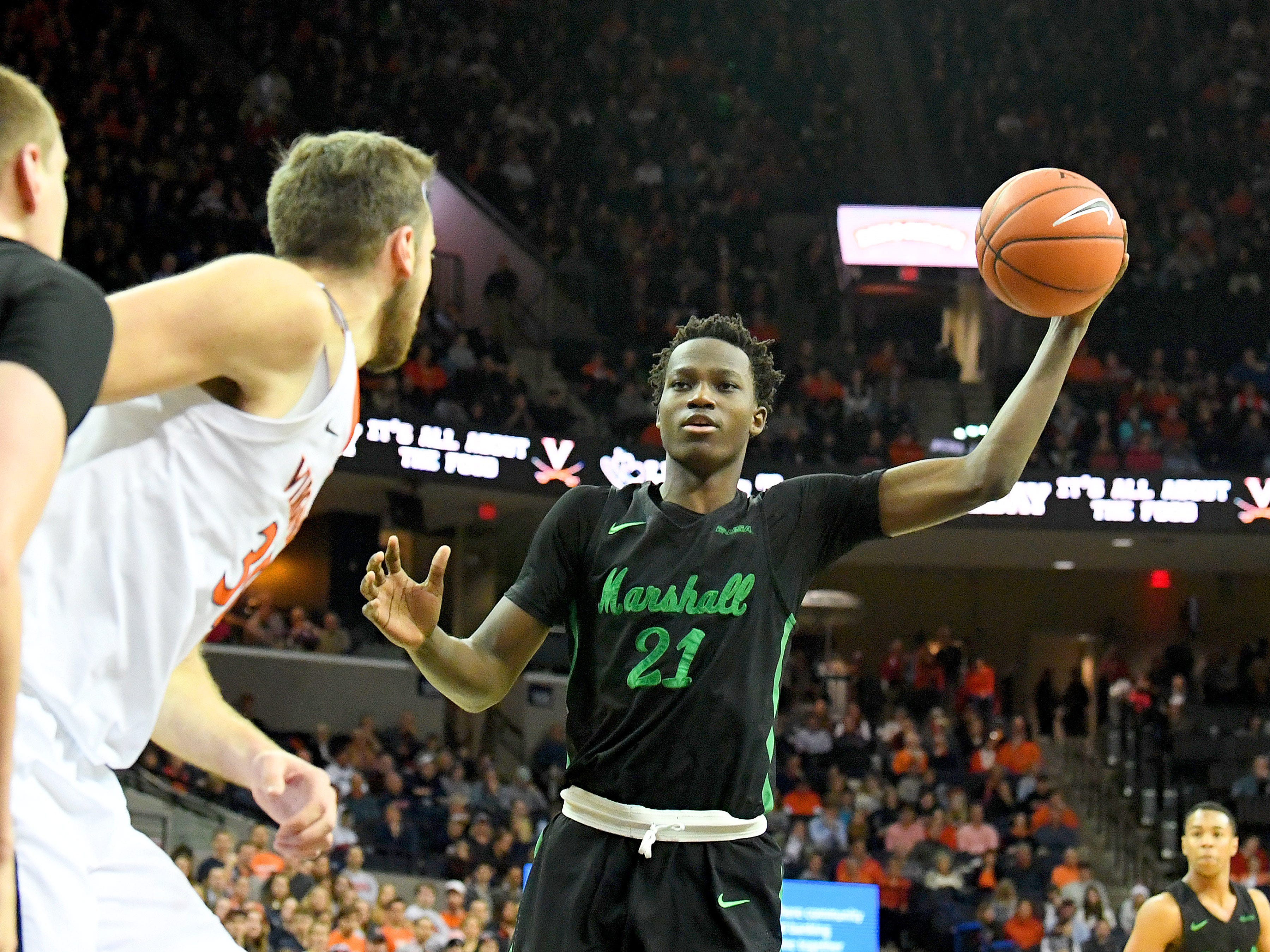 Marshall's Darius George, former R.E. Lee star, looks to pass the ball to a teammate during their game against University of Virginia, played at the John Paul Jones Arena on Dec. 31, 2016.