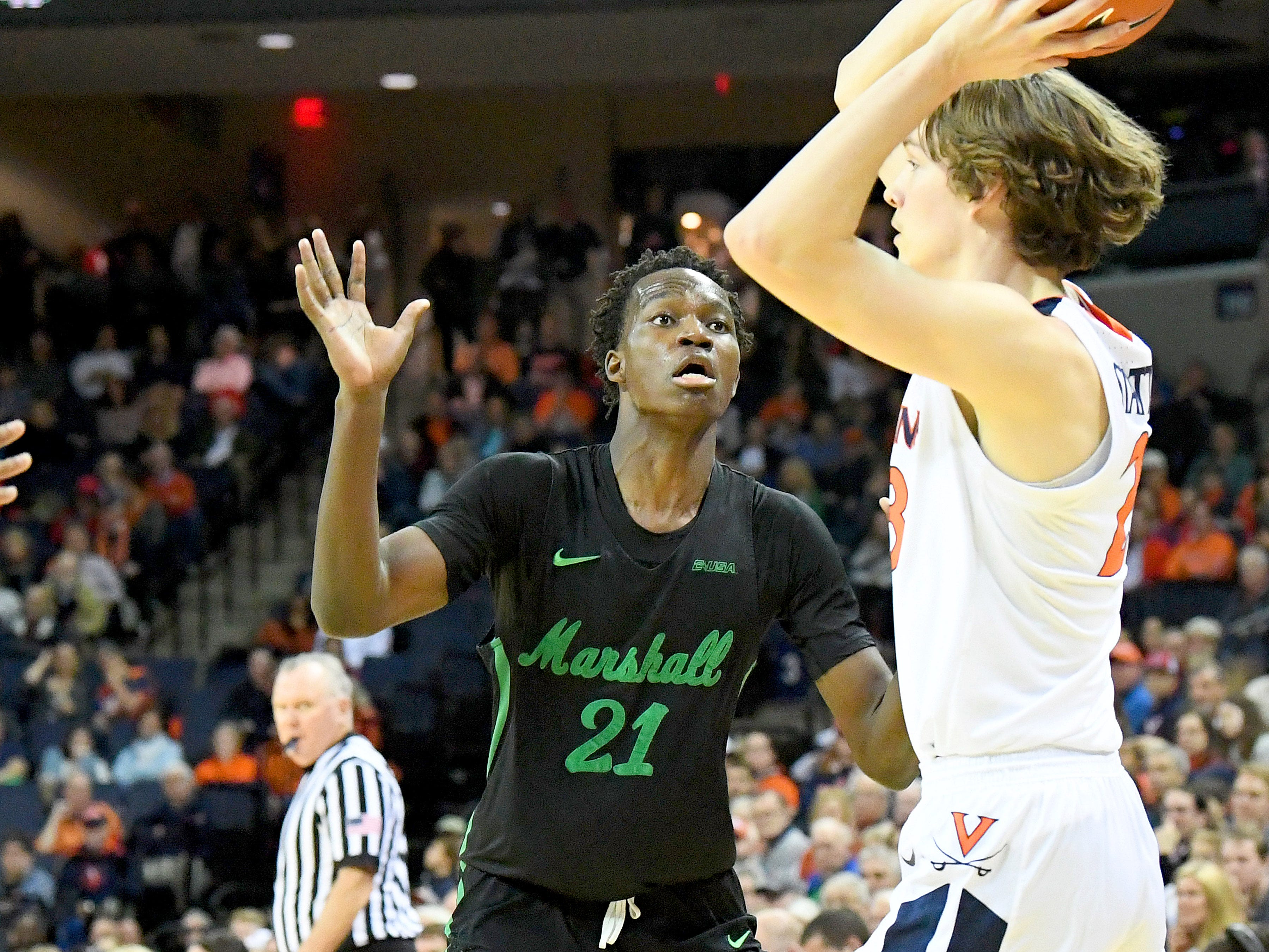Marshall's Darius George, former R.E. Lee star, guards  during their game against University of Virginia, played at the John Paul Jones Arena on Dec. 31, 2016.