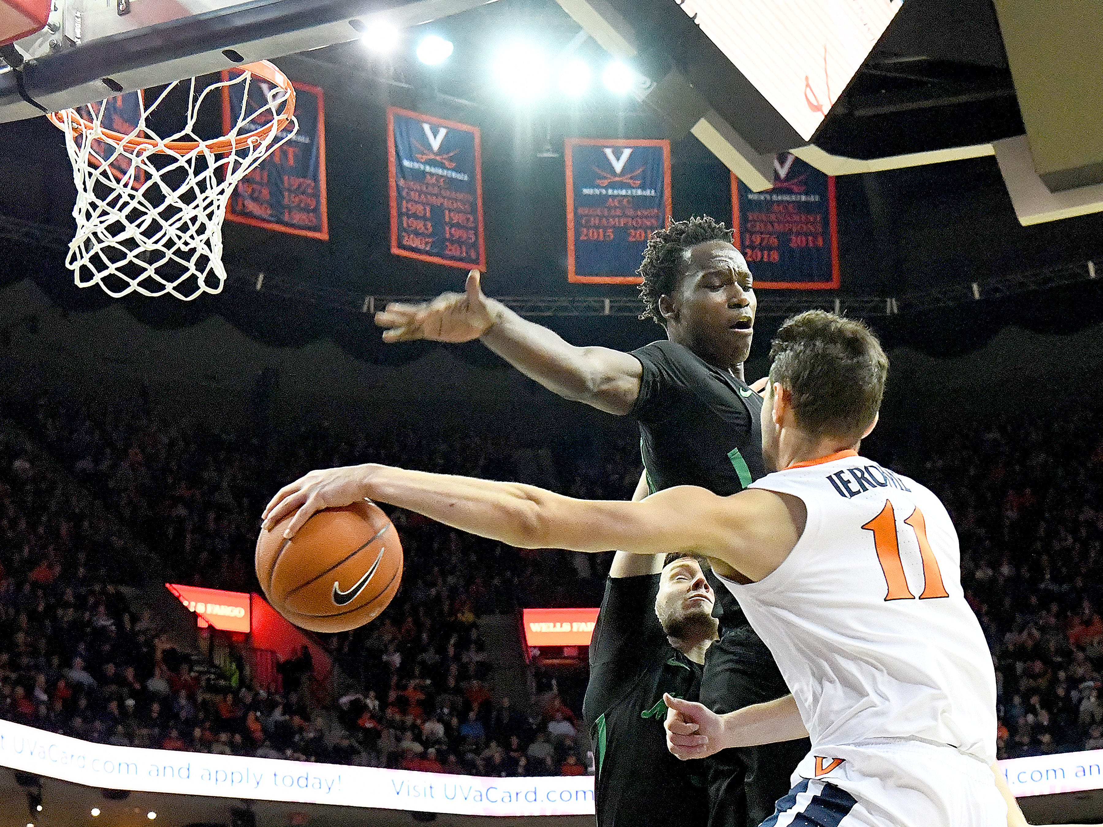 Marshall's Darius George, former R.E. Lee star, guards against Virginia's Ty Jerome during their game against University of Virginia, played at the John Paul Jones Arena on Dec. 31, 2016.