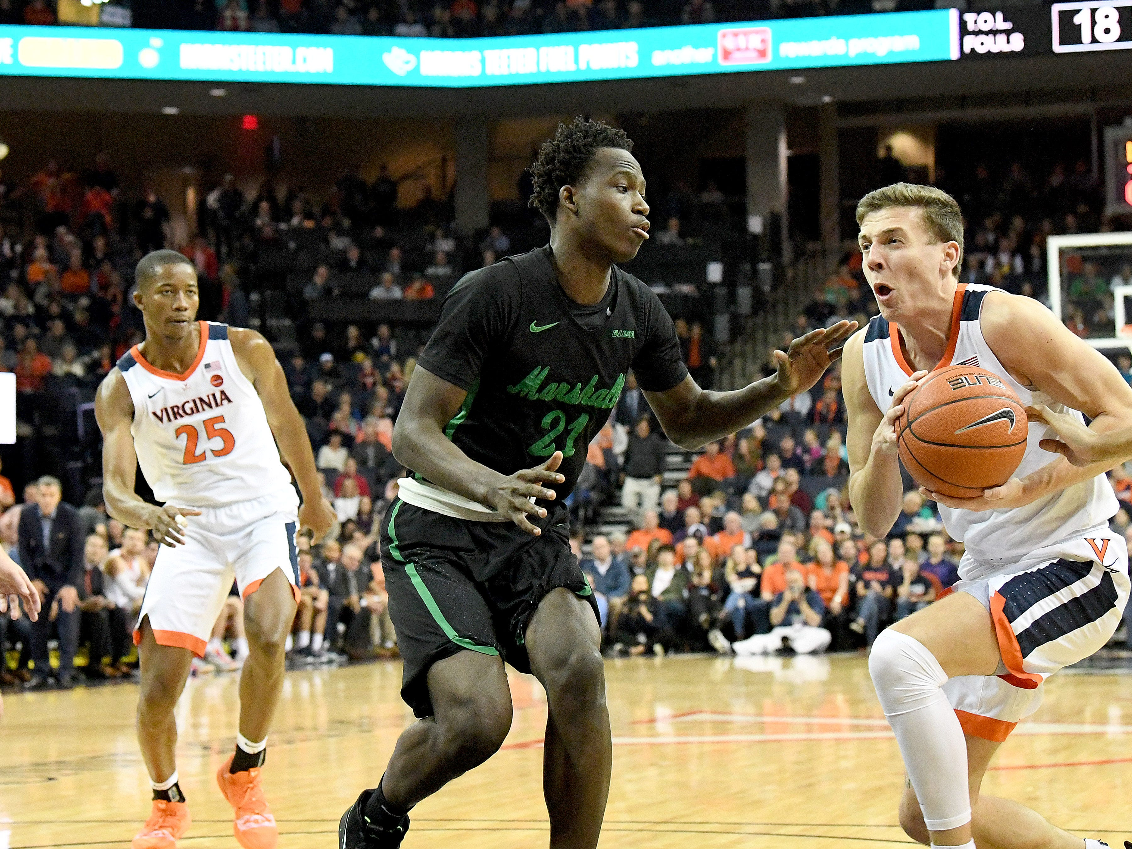Marshall's Darius George, former R.E. Lee star, guards against Virginia's Kyle Guy during their game against University of Virginia, played at the John Paul Jones Arena on Dec. 31, 2016.