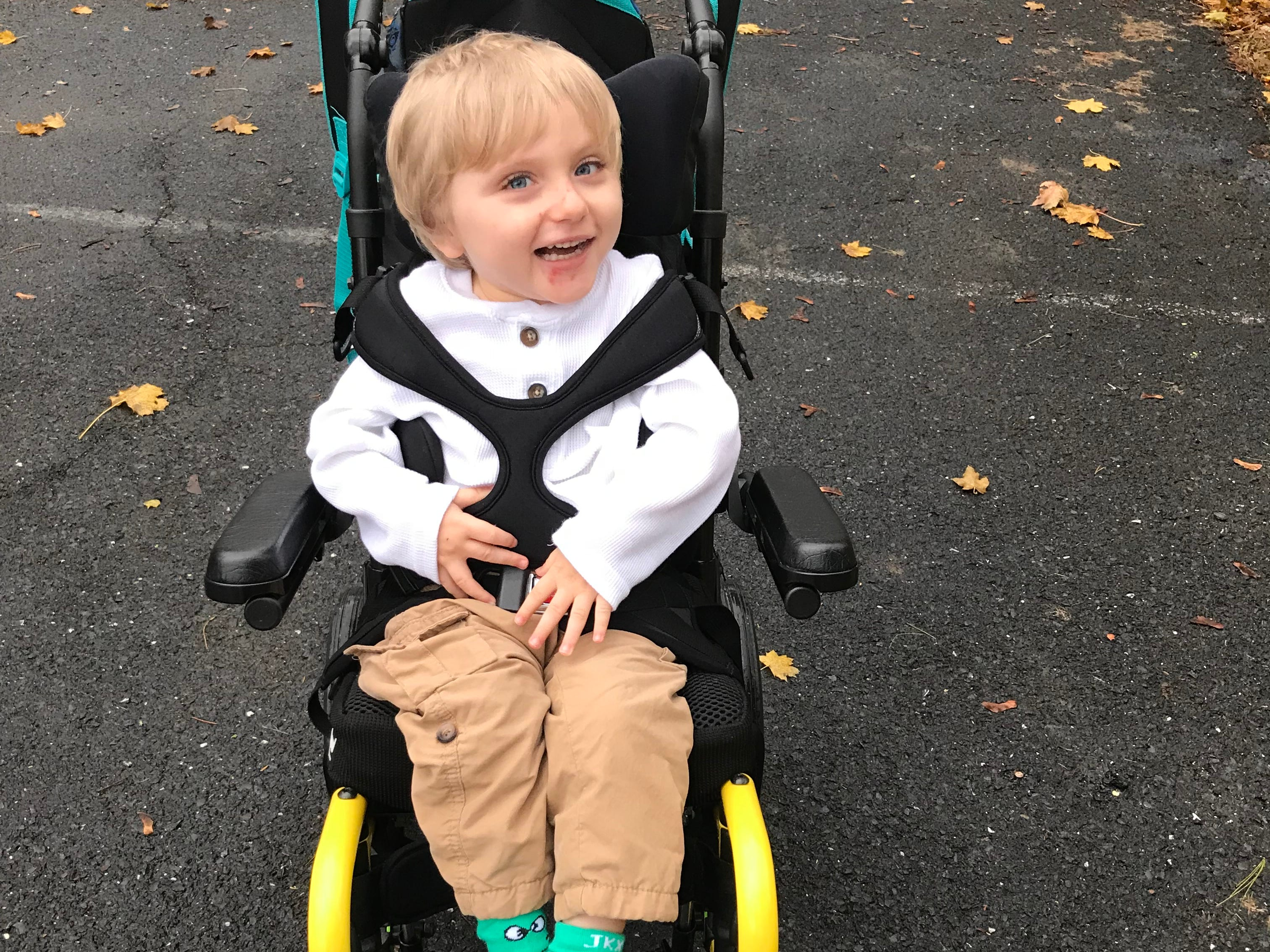 Carson Tugman, 3, of Staunton, waiting for the school to Dixon Educational Center. Tugman suffers from a progressive neurodevelopmental disorder caused by a pathogenic variant of the MECP2 gene known as Rett Syndrome.
