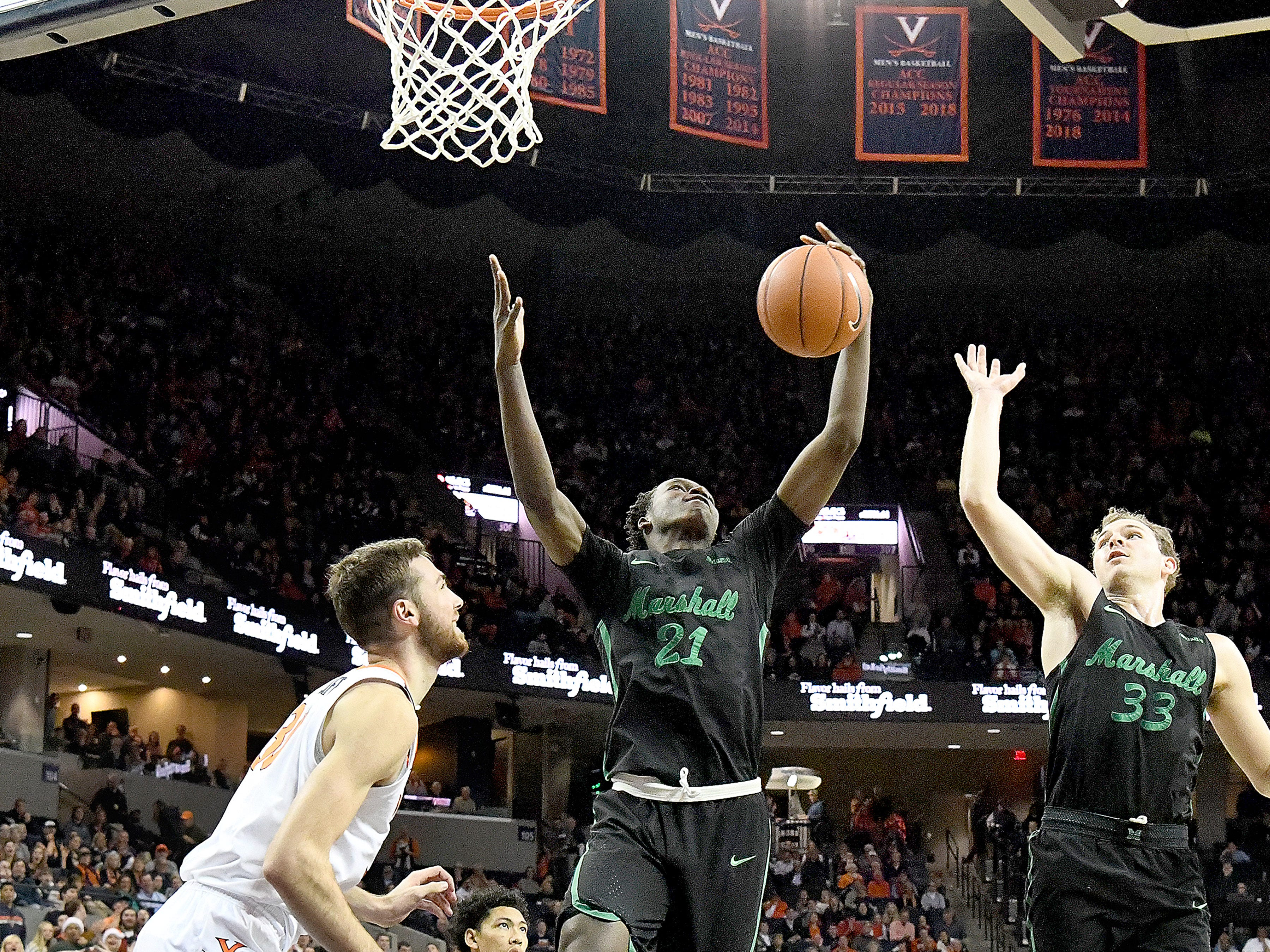 Marshall's Darius George, former R.E. Lee star, comes in under the basket to take control of the rebound during their game against University of Virginia, played at the John Paul Jones Arena on Dec. 31, 2016.