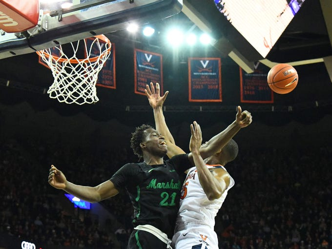Marshall's Darius George, former R.E. Lee star, flies in from the side to deflect the rebound to a teammate during their game against University of Virginia, played at the John Paul Jones Arena on Dec. 31, 2016.