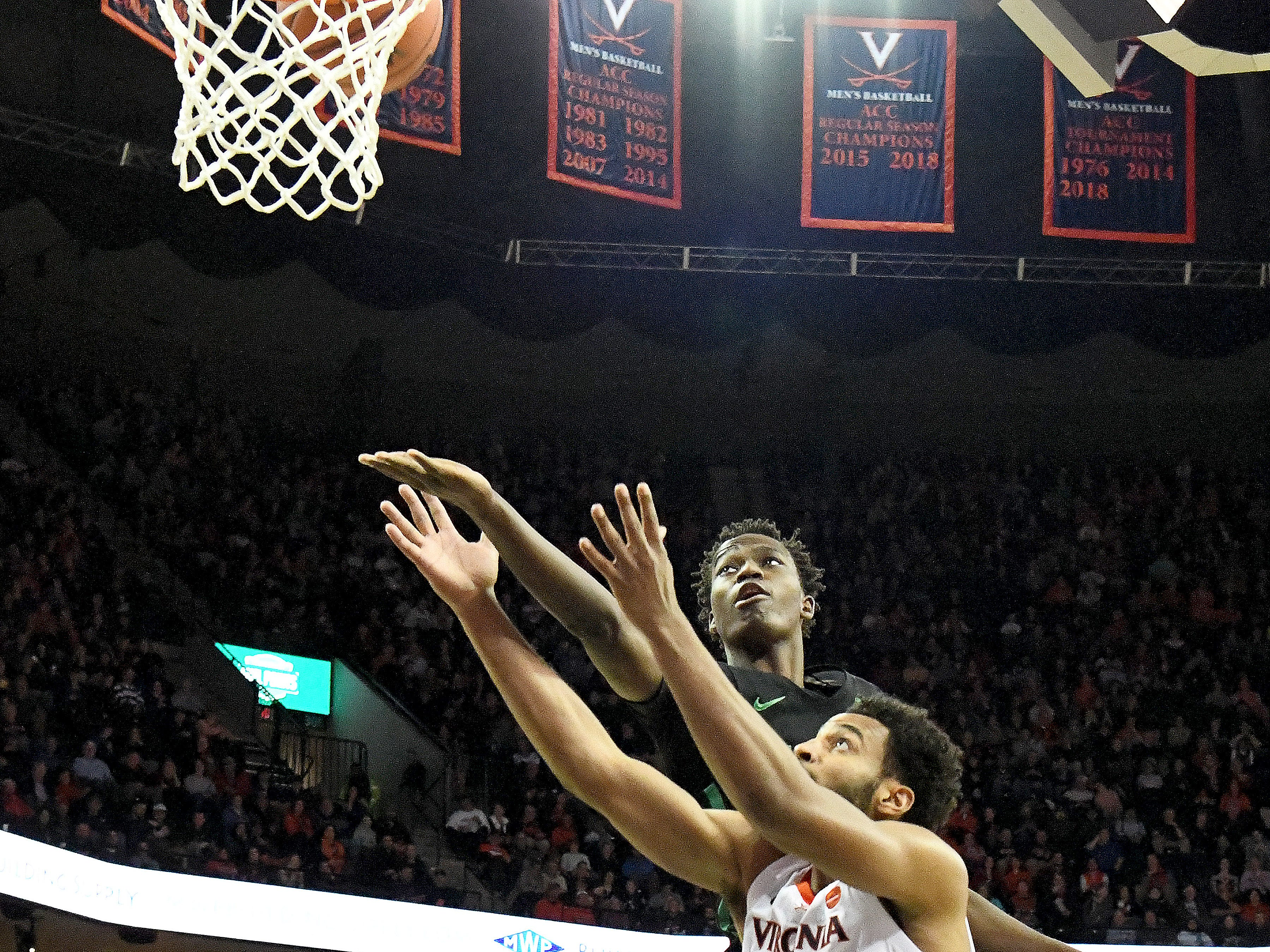 Marshall's Darius George, former R.E. Lee star, tries to reach the basket with the ball as he shoots during their game against University of Virginia, played at the John Paul Jones Arena on Dec. 31, 2016.