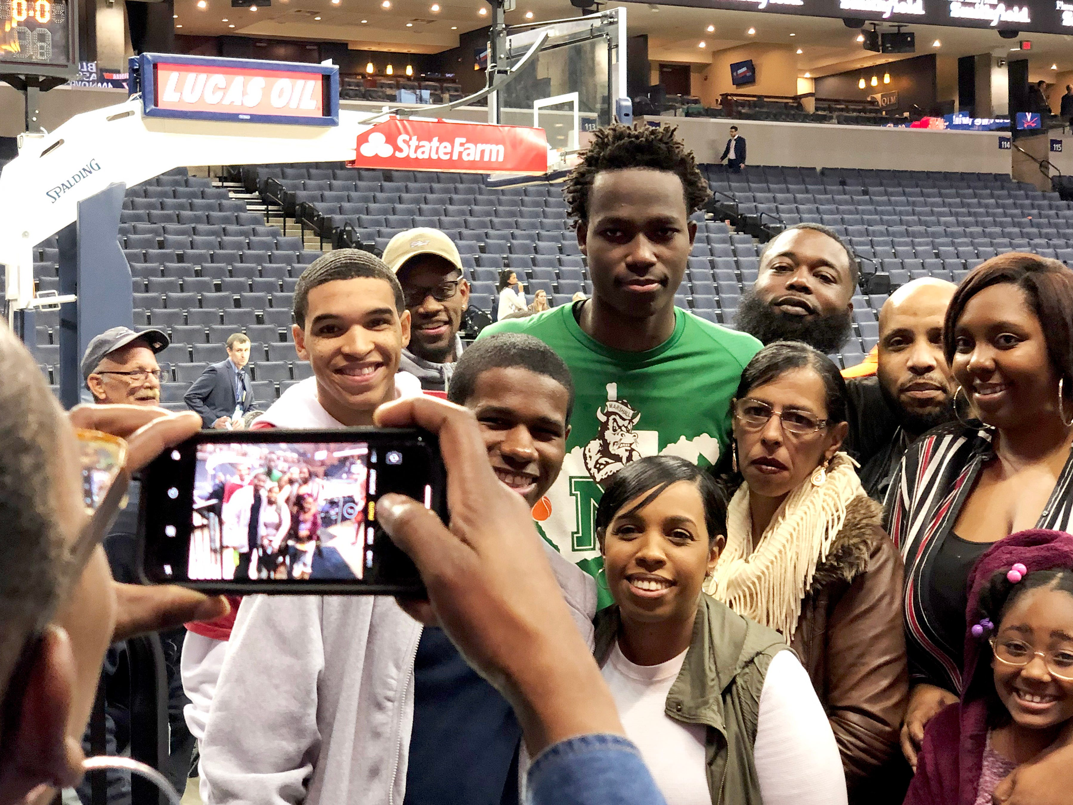 Marshall's Darius George, former R.E. Lee star, guards with family and friends after Marshall's game against the University of Virginia, played at the John Paul Jones Arena on Dec. 31, 2016.