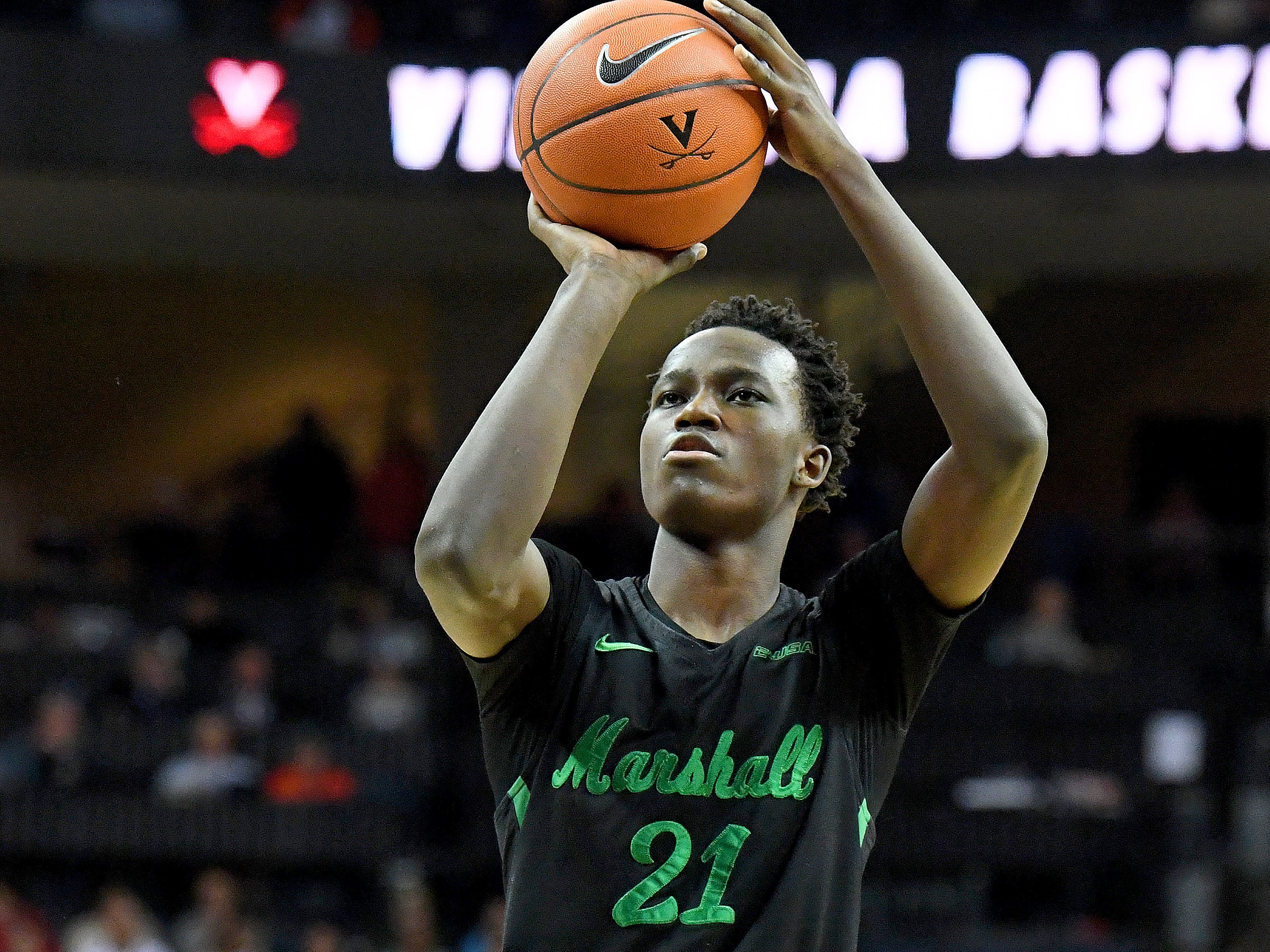 Marshall's Darius George, former R.E. Lee star, shoots a free-throw during their game against University of Virginia, played at the John Paul Jones Arena on Dec. 31, 2016.
