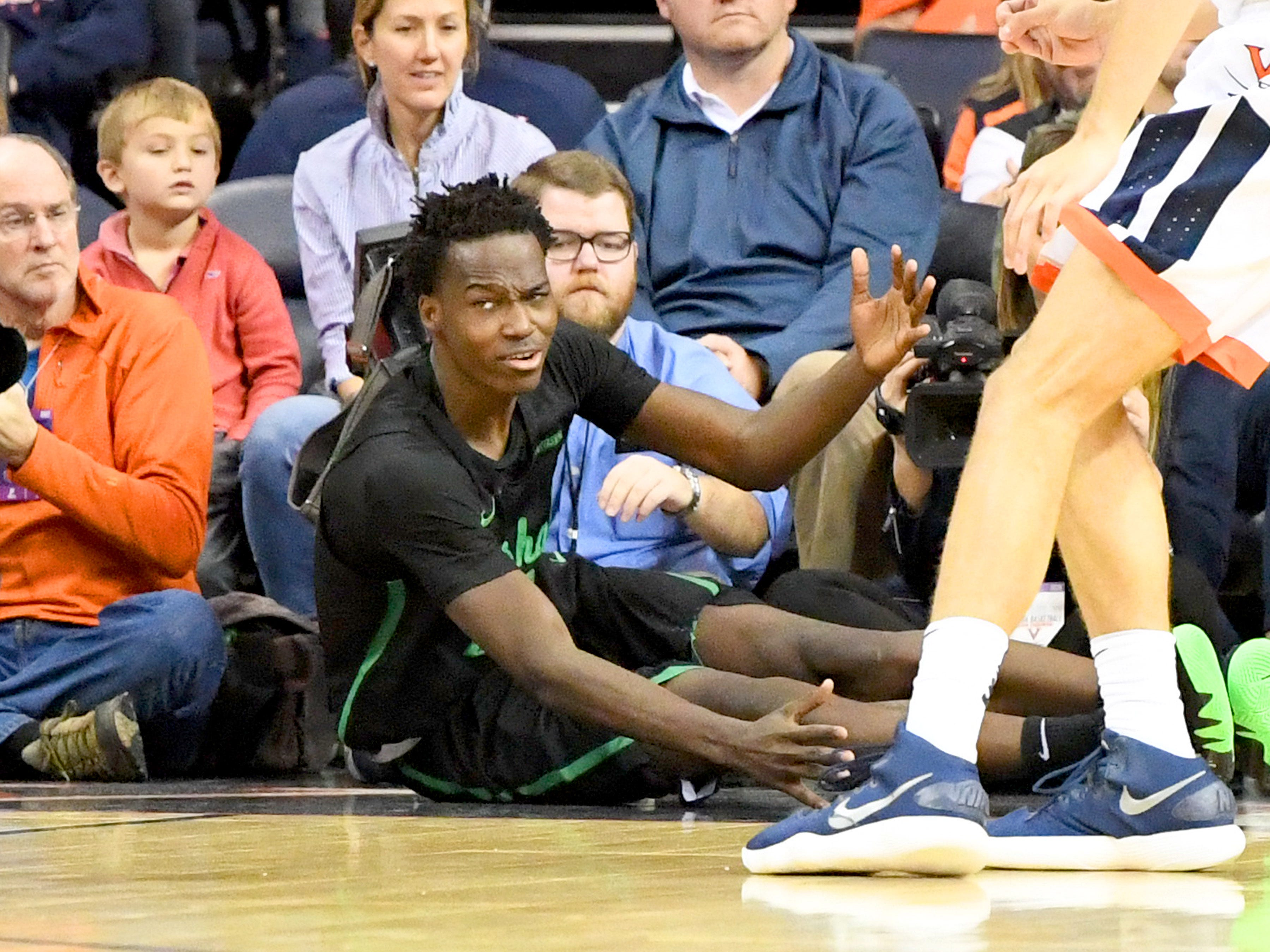 Marshall's Darius George, former R.E. Lee star, reacts after going down along one end of the court during their game against University of Virginia, played at the John Paul Jones Arena on Dec. 31, 2016.