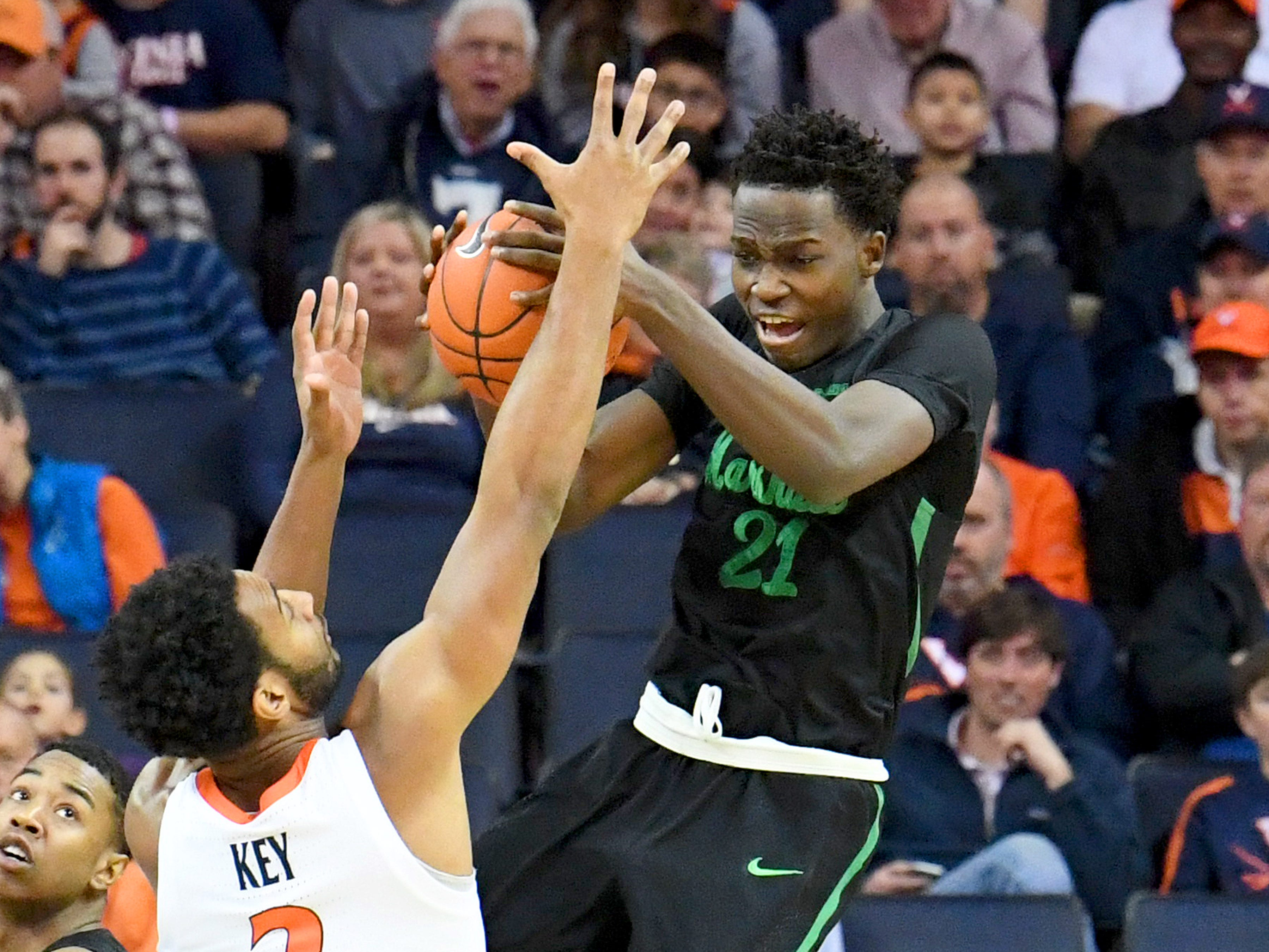 Marshall's Darius George, former R.E. Lee star, snatches the rebound after going high during their game against University of Virginia, played at the John Paul Jones Arena on Dec. 31, 2016.