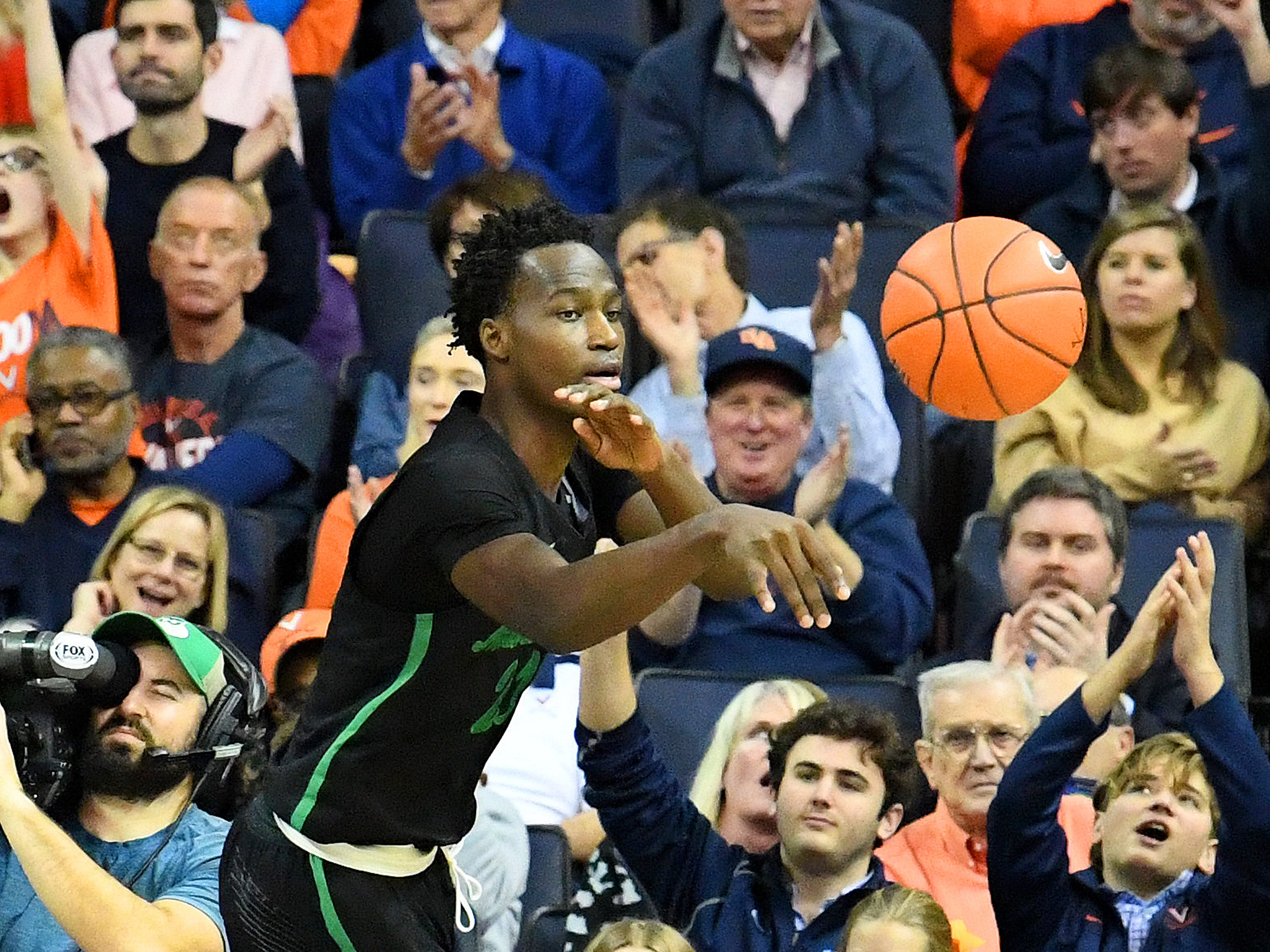 Marshall's Darius George, former R.E. Lee star, passes the ball during their game against University of Virginia, played at the John Paul Jones Arena on Dec. 31, 2016.