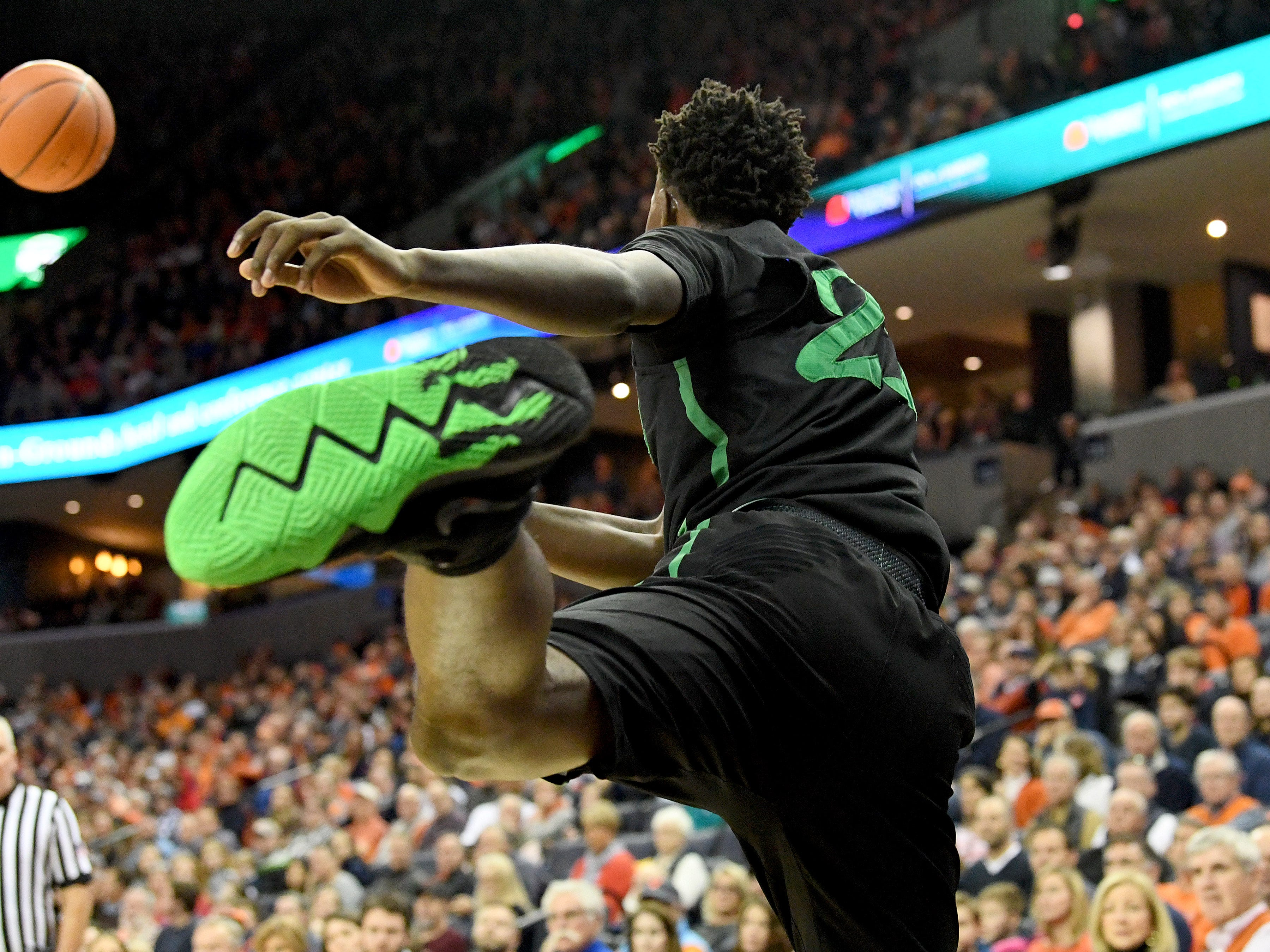 Marshall's Darius George, former R.E. Lee star, flies through the air to keep the ball in bounds and in play during their game against University of Virginia, played at the John Paul Jones Arena on Dec. 31, 2016.