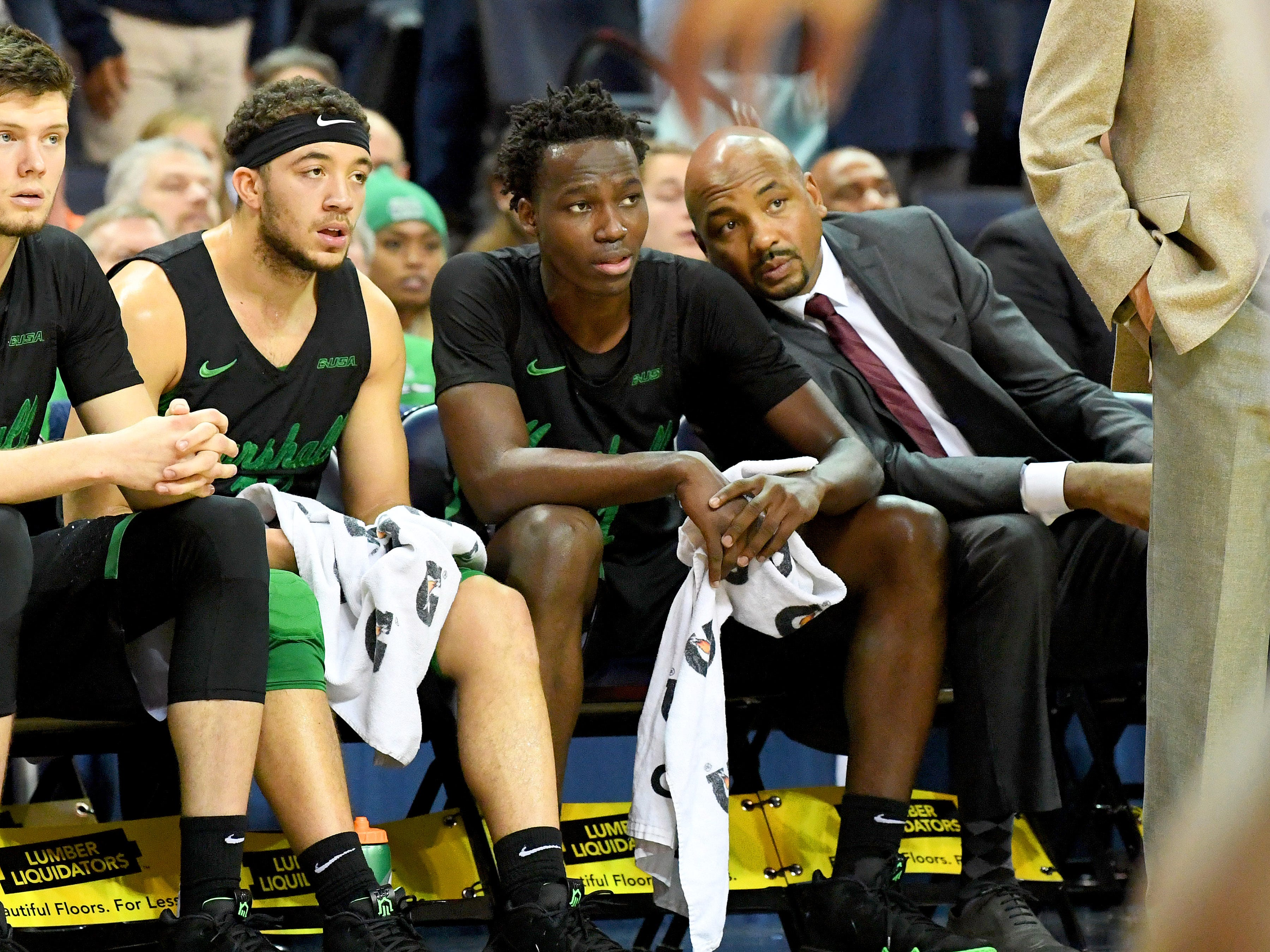 Marshall's Darius George (center), former R.E. Lee star, watches the action on the court from the bench during their game against University of Virginia, played at the John Paul Jones Arena on Dec. 31, 2016.