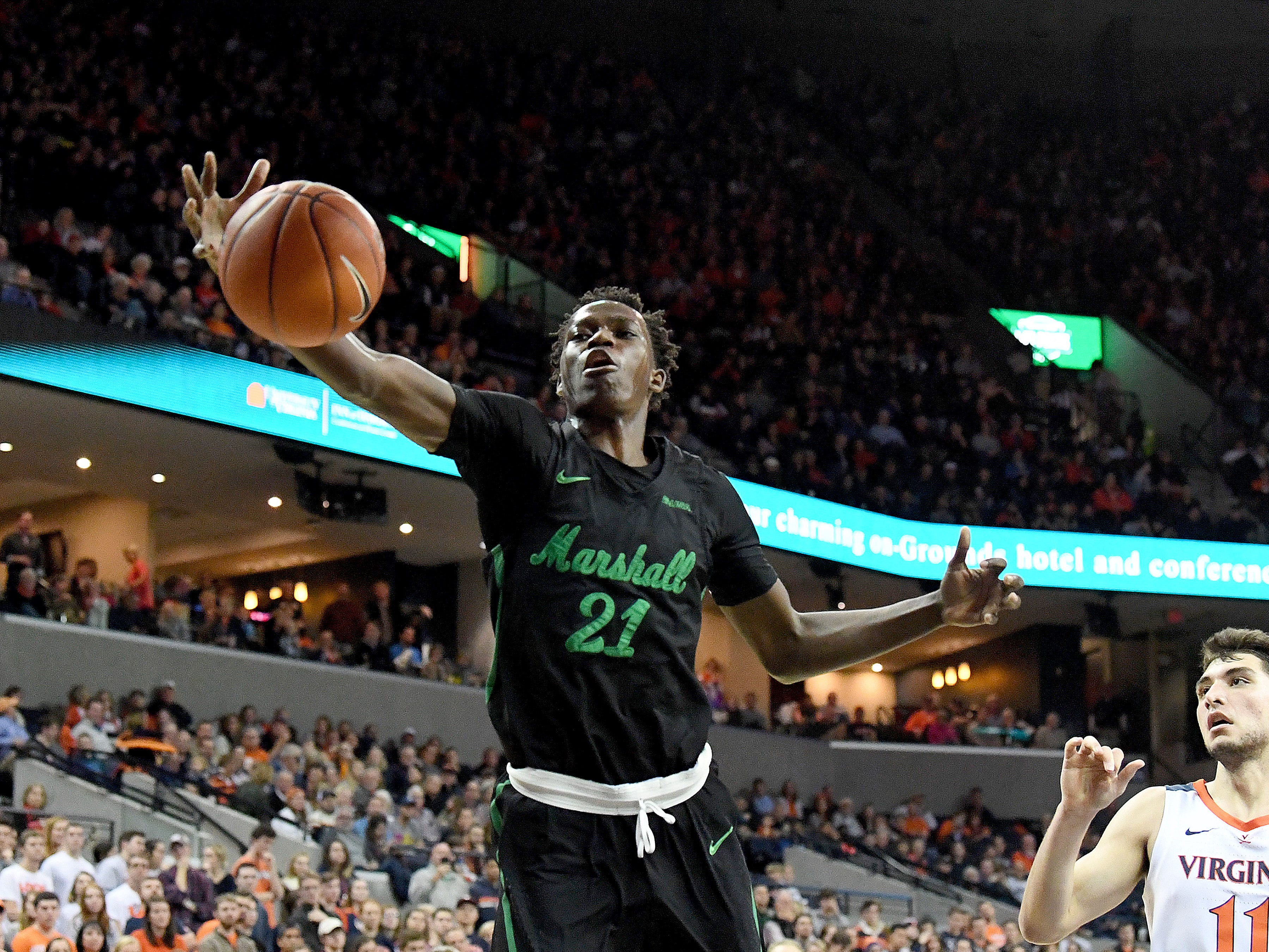 Marshall's Darius George, former R.E. Lee star, tries to snatch the rebound during their game against University of Virginia, played at the John Paul Jones Arena on Dec. 31, 2016.