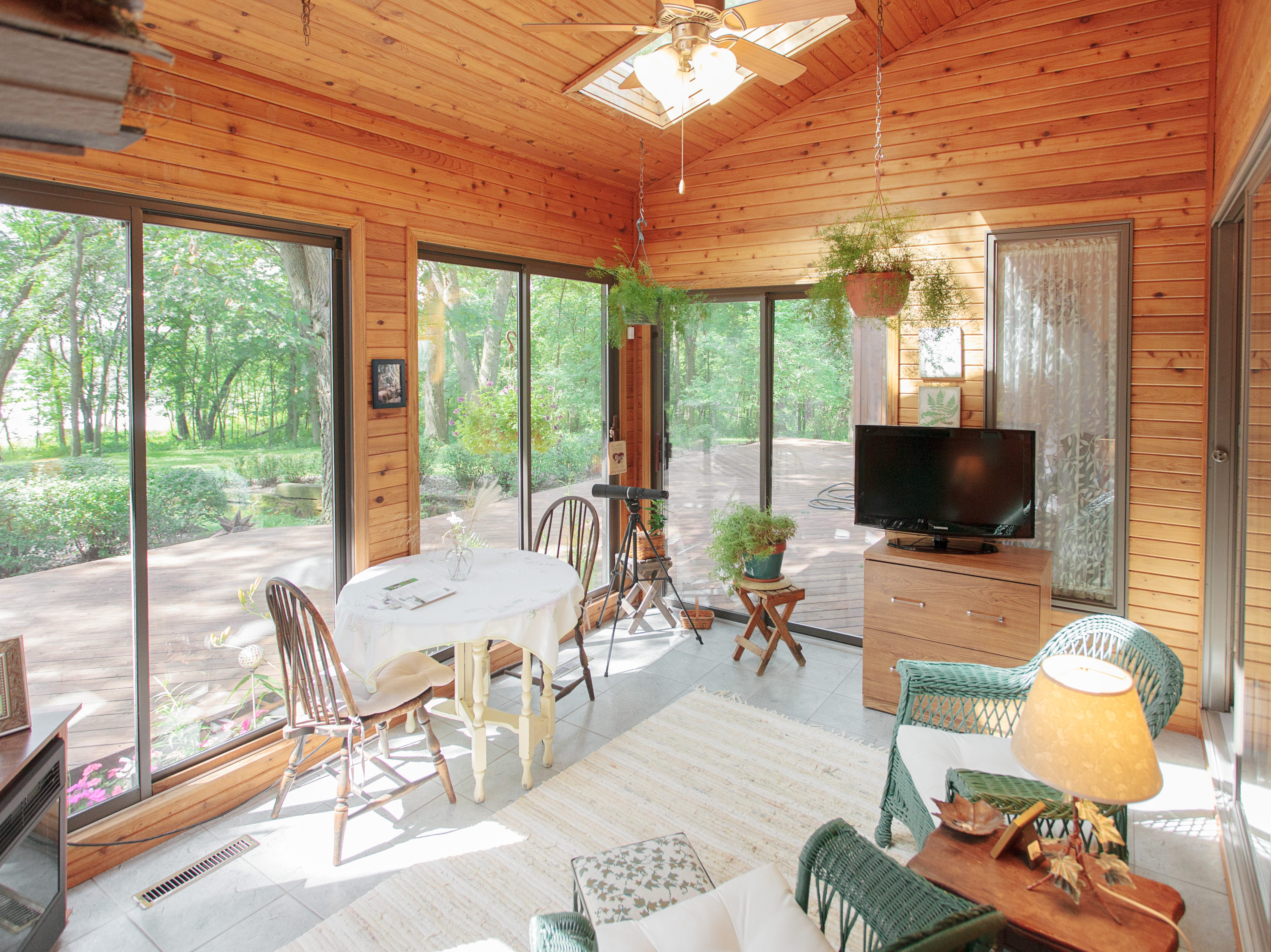 The sun room, with its own vaulted ceiling and skylights, provides the perfect place for taking it all in.