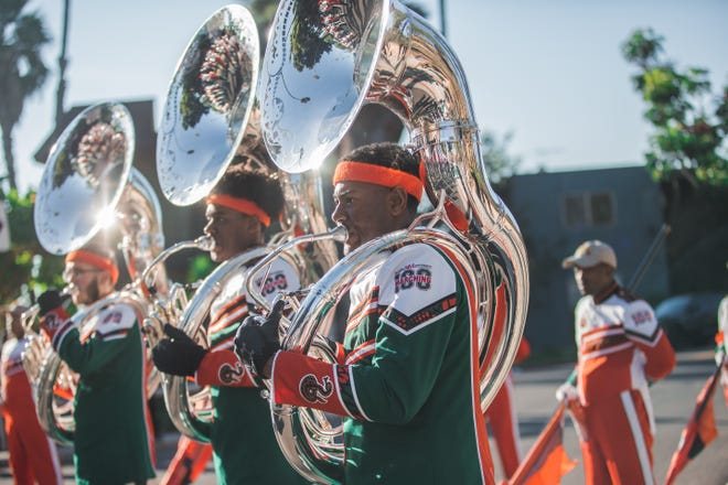 FAMU Marching 100 members perform out the First AME Church of Los Angeles, Sunday.