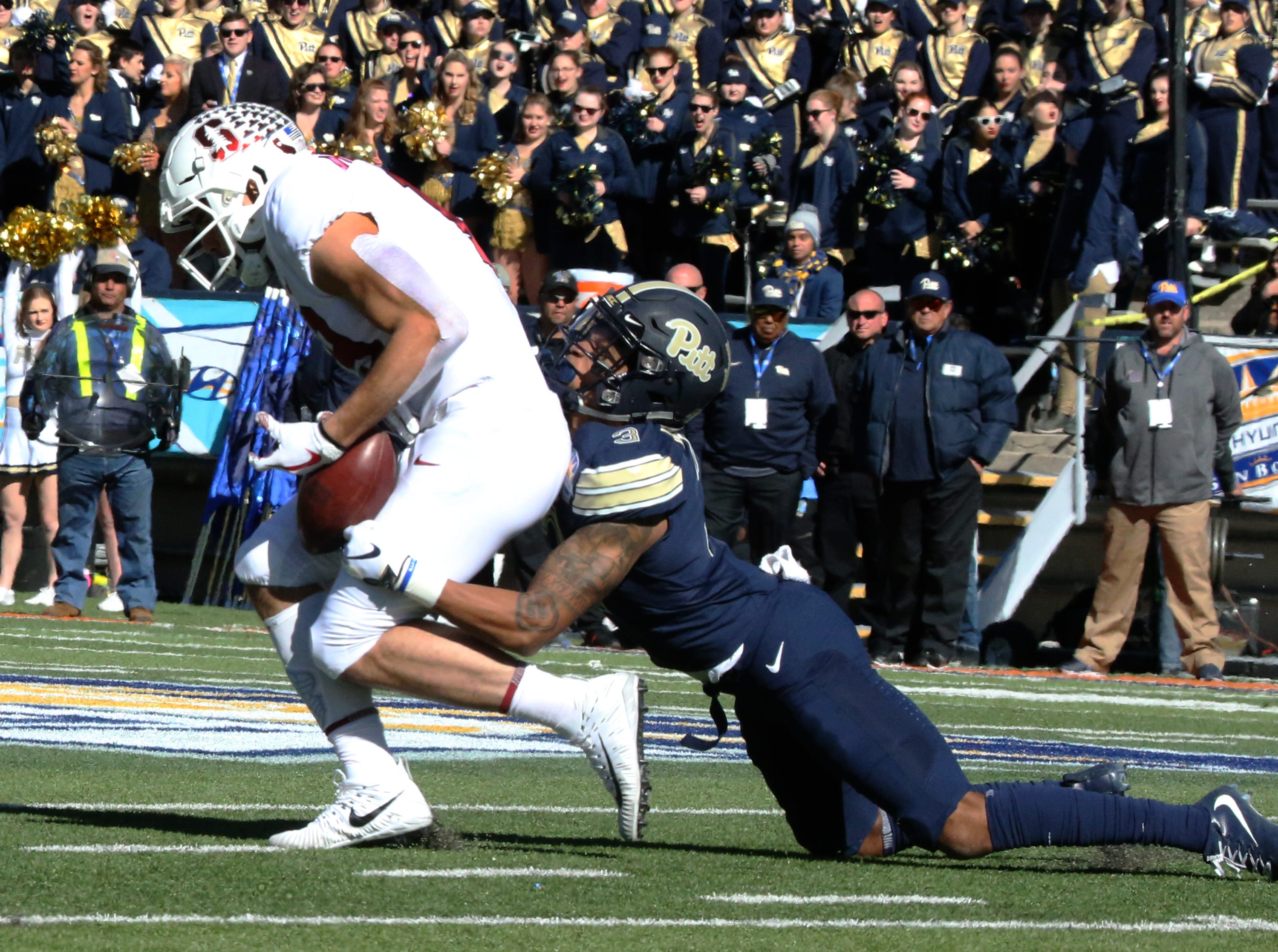 Stanford wide receiver JJ Arceaga-Whiteside, 19, loses the football after a shot pass reception attempt against Pitt Monday.