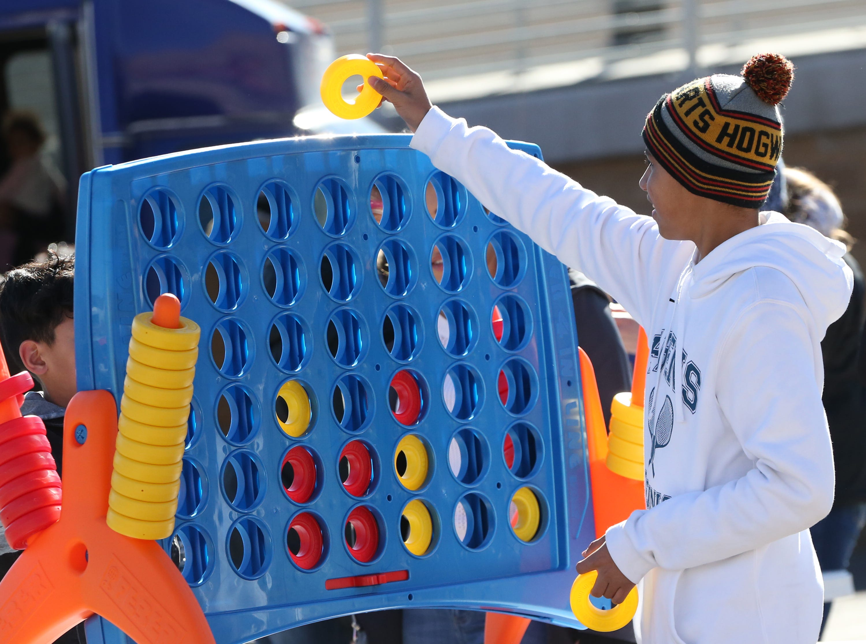 Marco Martinez of El Paso plays a 4 In Line game at a fan pre-game tailgate Monday.