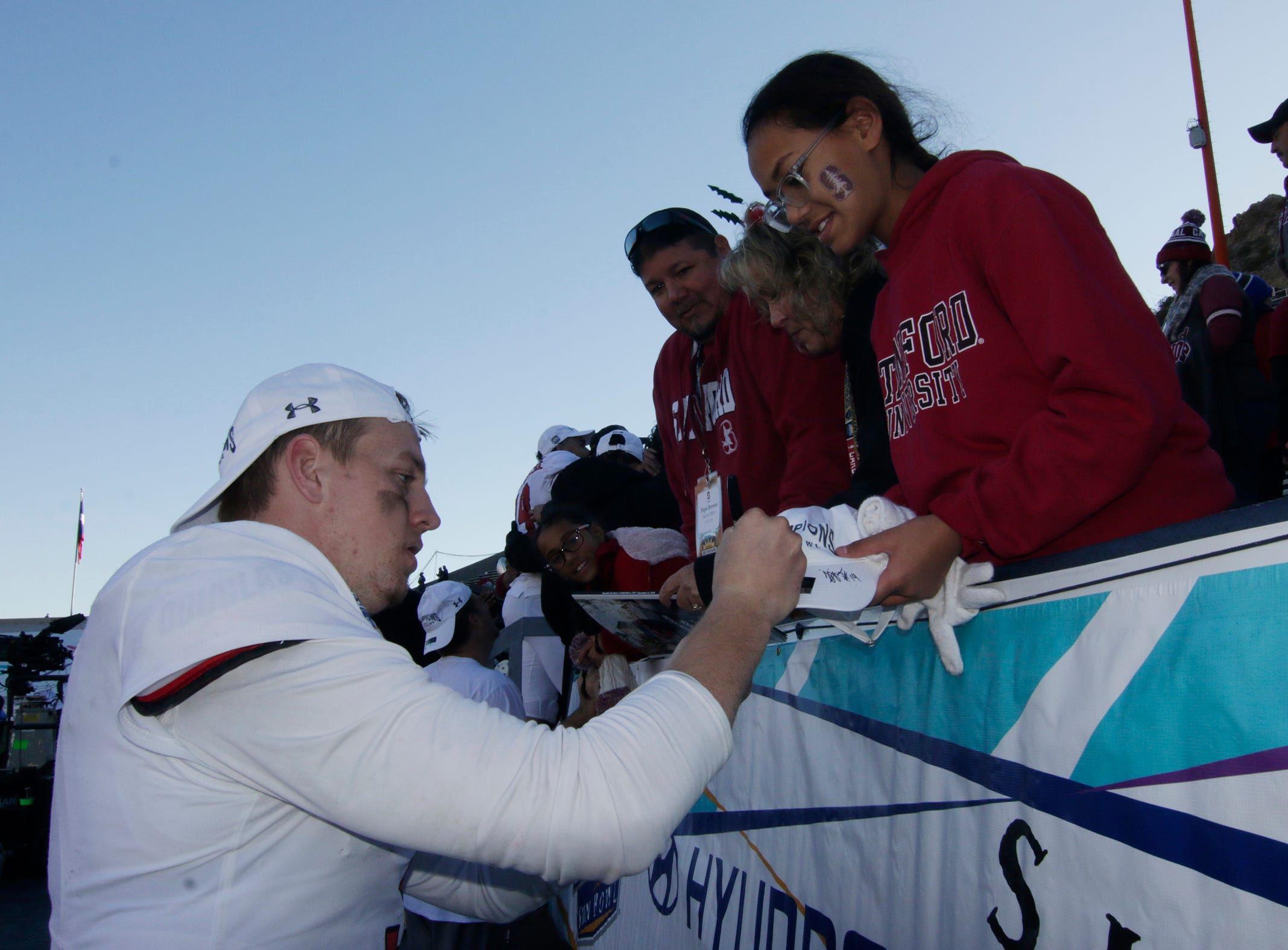 Stanford Cardinal quarterback K. J. Costello signs an autograph for a fan after he led his team to a come from behind win to beat Pitt 14-13 in the 85th Hyundai Sun Bowl.