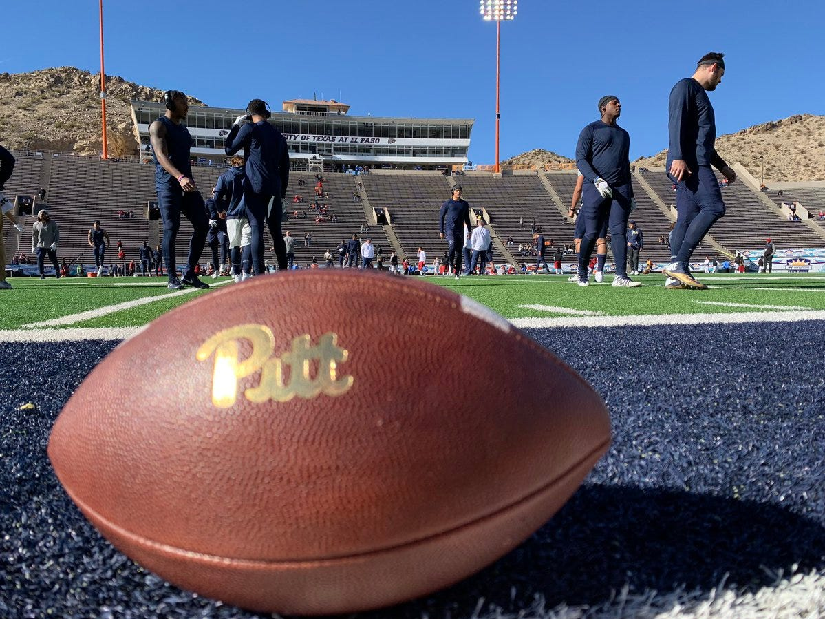 Members of the Pitt Panthers football team stretch out during pre-game drills.
