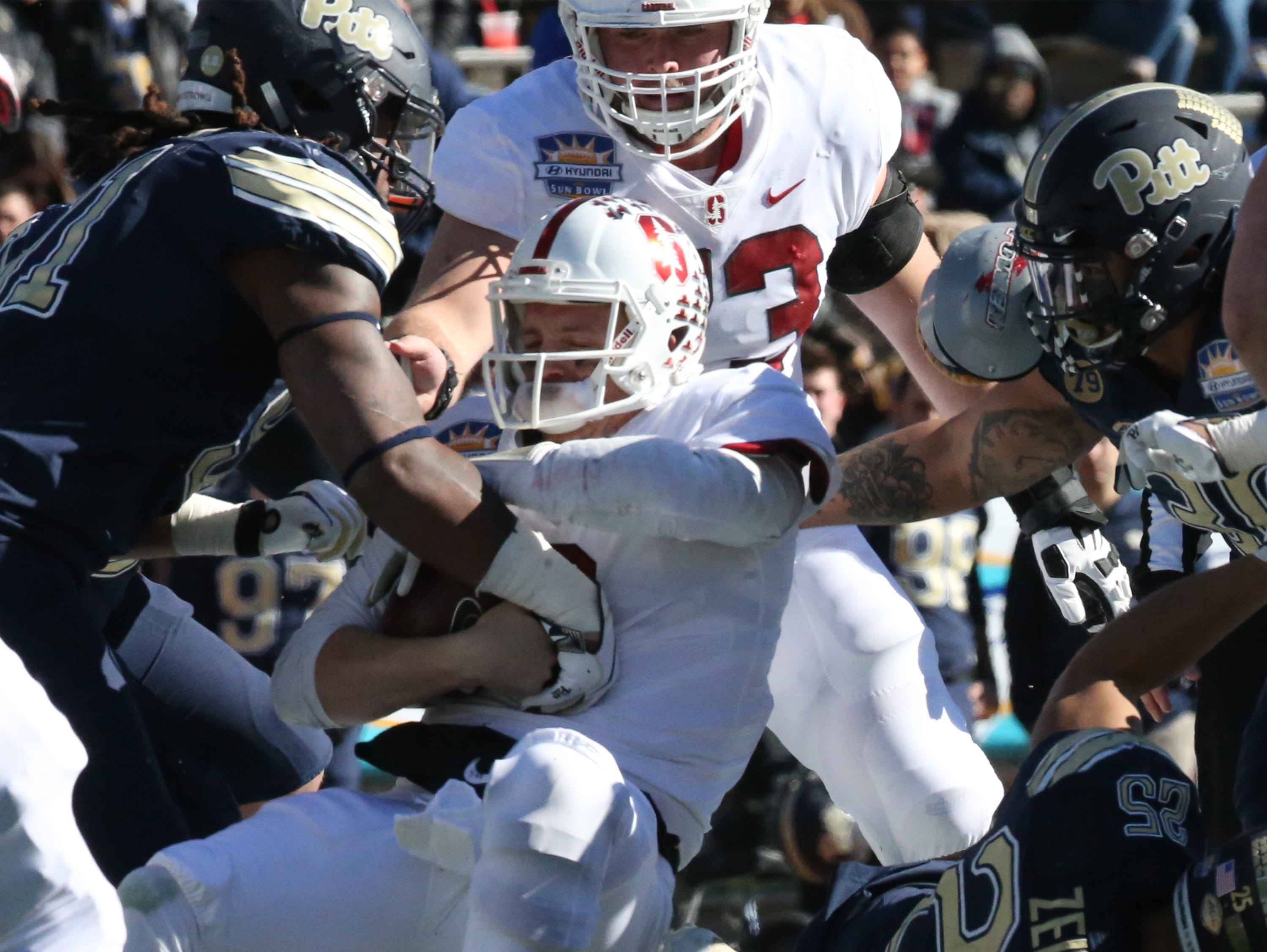 Stanford quarterback K.J. Costello, 3, is caught during a short keeper play against Pitt in the 85th Hyundai Sun Bowl game Monday.