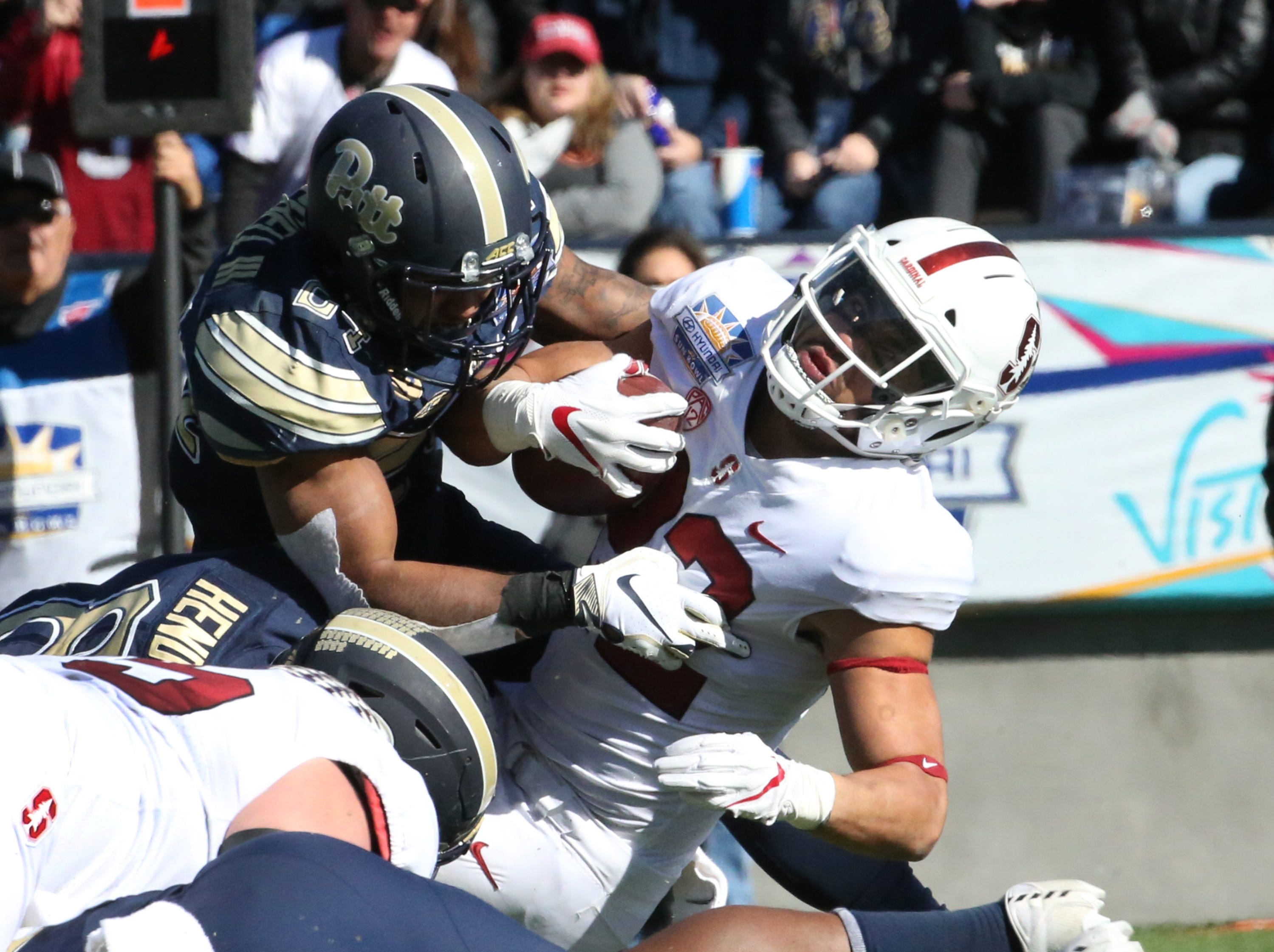 Stanford running back Cameron Scarlett, 22, makes it to the on yard line setting of an Cardinal touchdown against Pitt in the 85th Hyundai Sun Bowl game Monday, Dec. 31.
