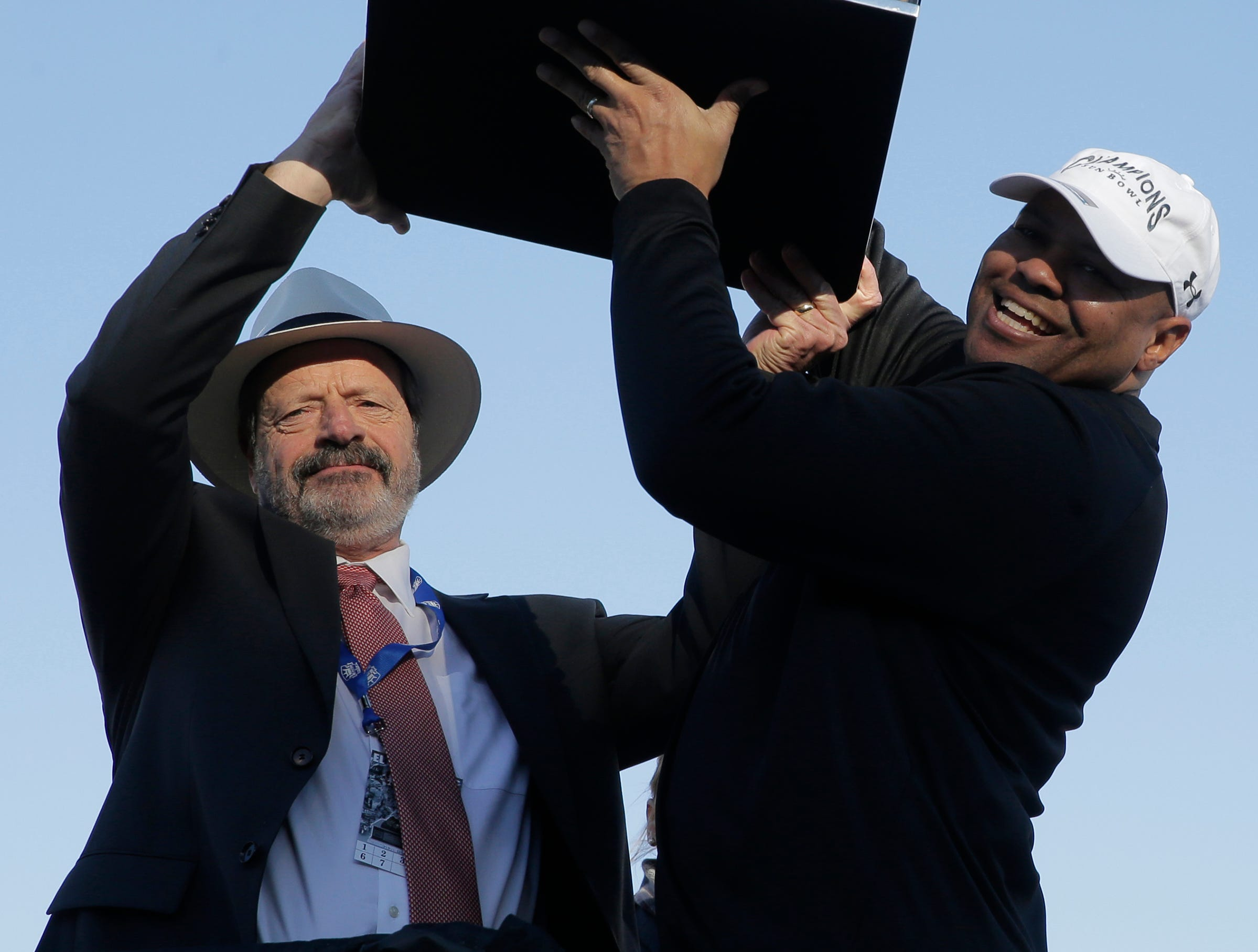 Former El Paso Mayor Oscar Leeser holds up the Hyundai Sun Bowl Championship trophy with Stanford head coach David Shaw after his Cradinal teamd defeated Pitt 14-13 to win the 85th Hyundai Sun Bowl.
