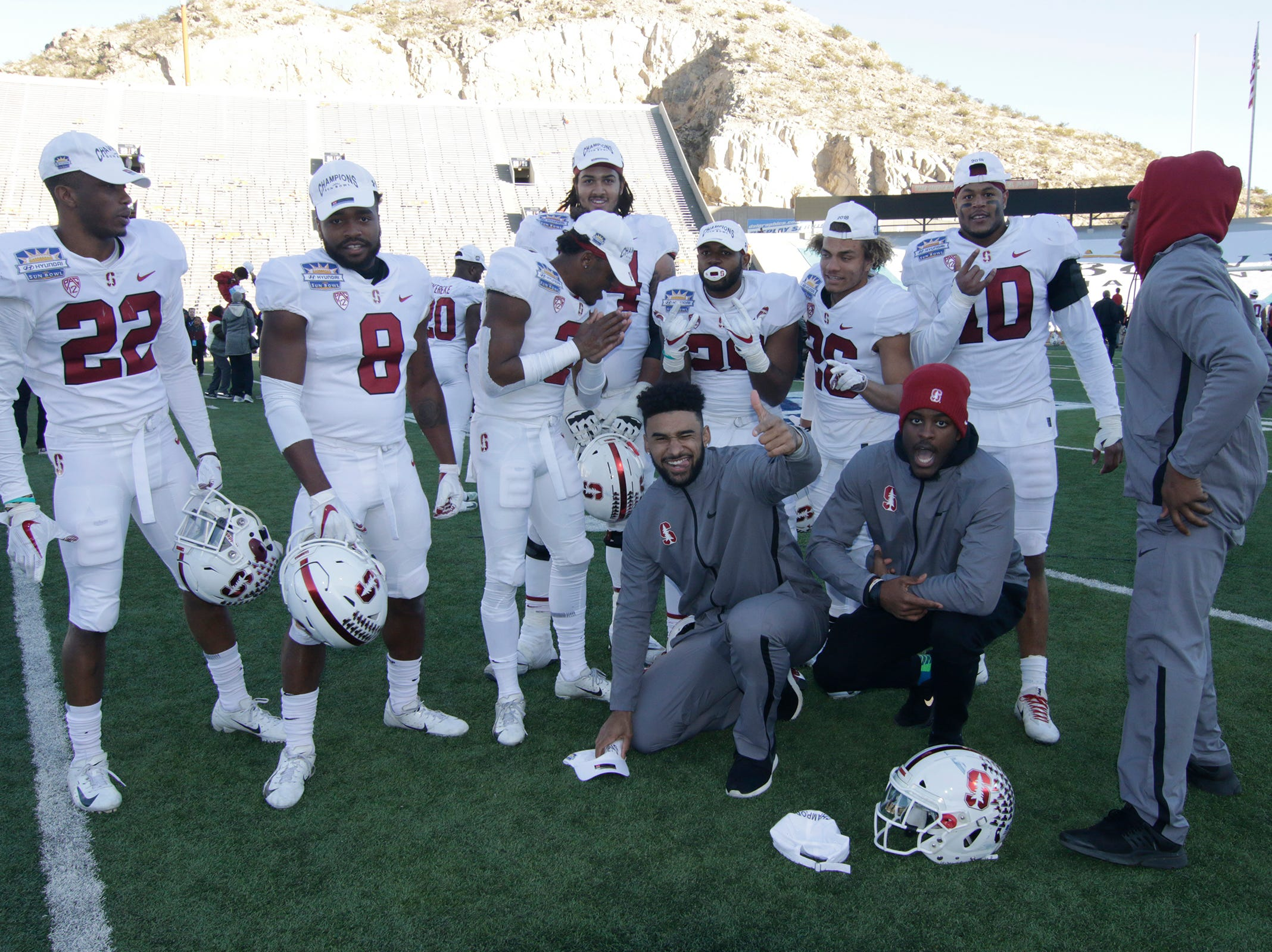 Members of the Stanford football team pose for a photo after they defeated the Pitt Panthers 14-13 in the 85th Hyundai Sun Bowl.